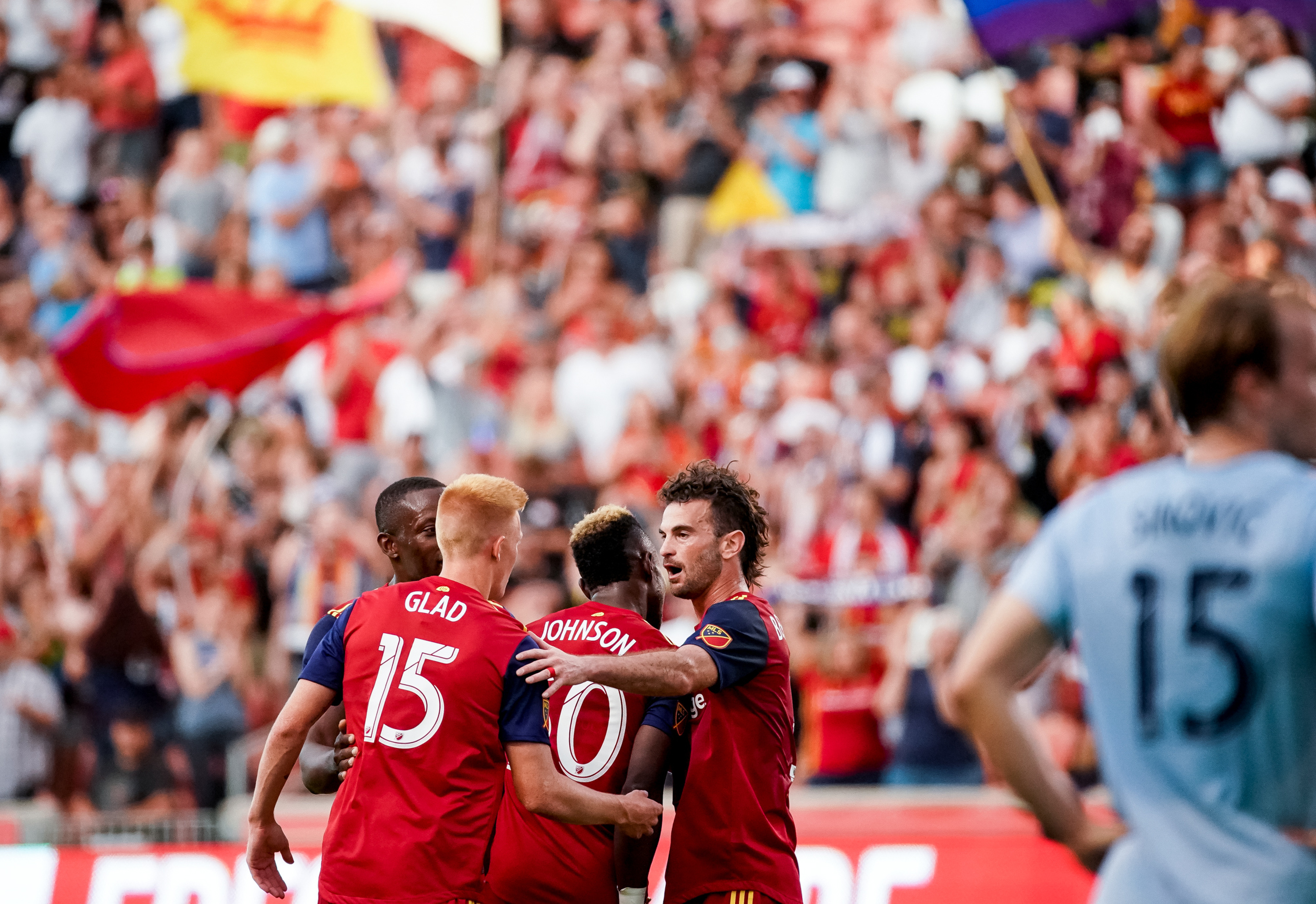 Real Salt Lake defender Nedum Onuoha (14), defender Justen Glad (15), forward Sam Johnson (50) and midfielder Kyle Beckerman (5) celebrate after Johnson scored on Sporting Kansas City at Rio Tinto Stadium in Sandy on Saturday, June 29, 2019.