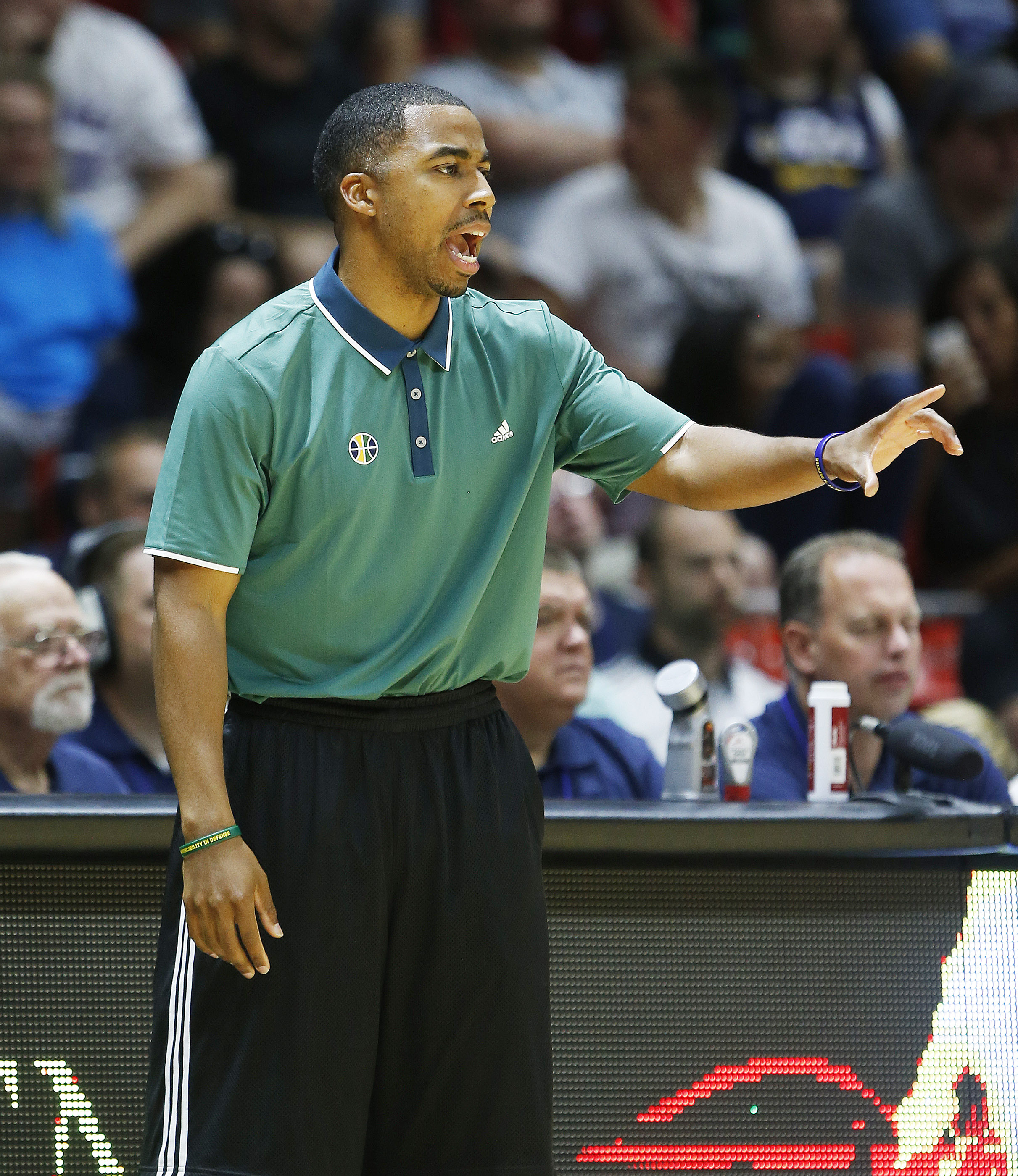 Utah Jazz coach Johnnie Bryant shouts instruction during the summer league game in Salt Lake City on Thursday, July 7, 2016.