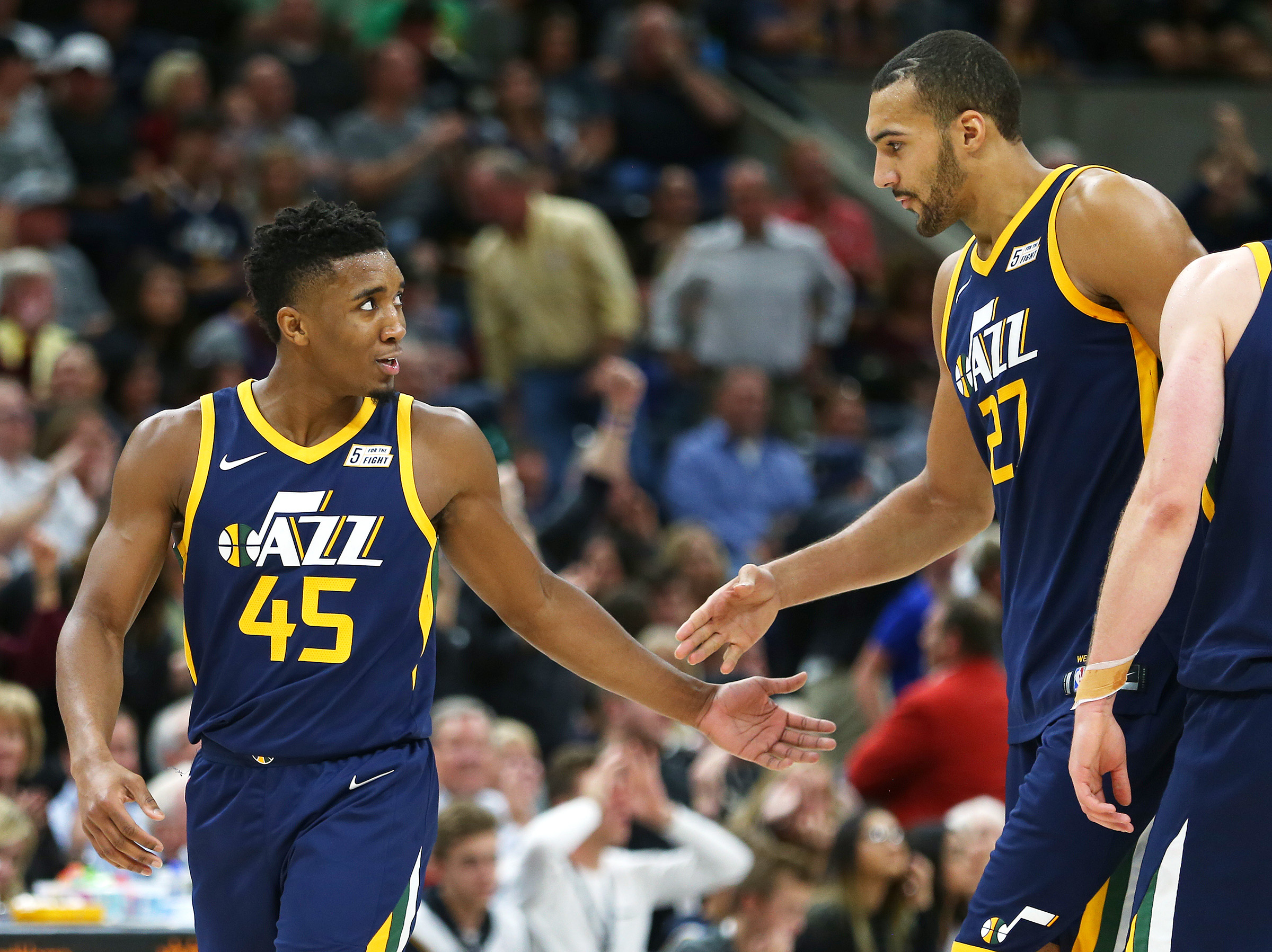 Utah Jazz guard Donovan Mitchell (45) and Utah Jazz center Rudy Gobert (27) give each other five during a timeout as the Utah Jazz and the L.A. Lakers play at Vivint Arena in Salt Lake City on Saturday, Oct. 28, 2017.