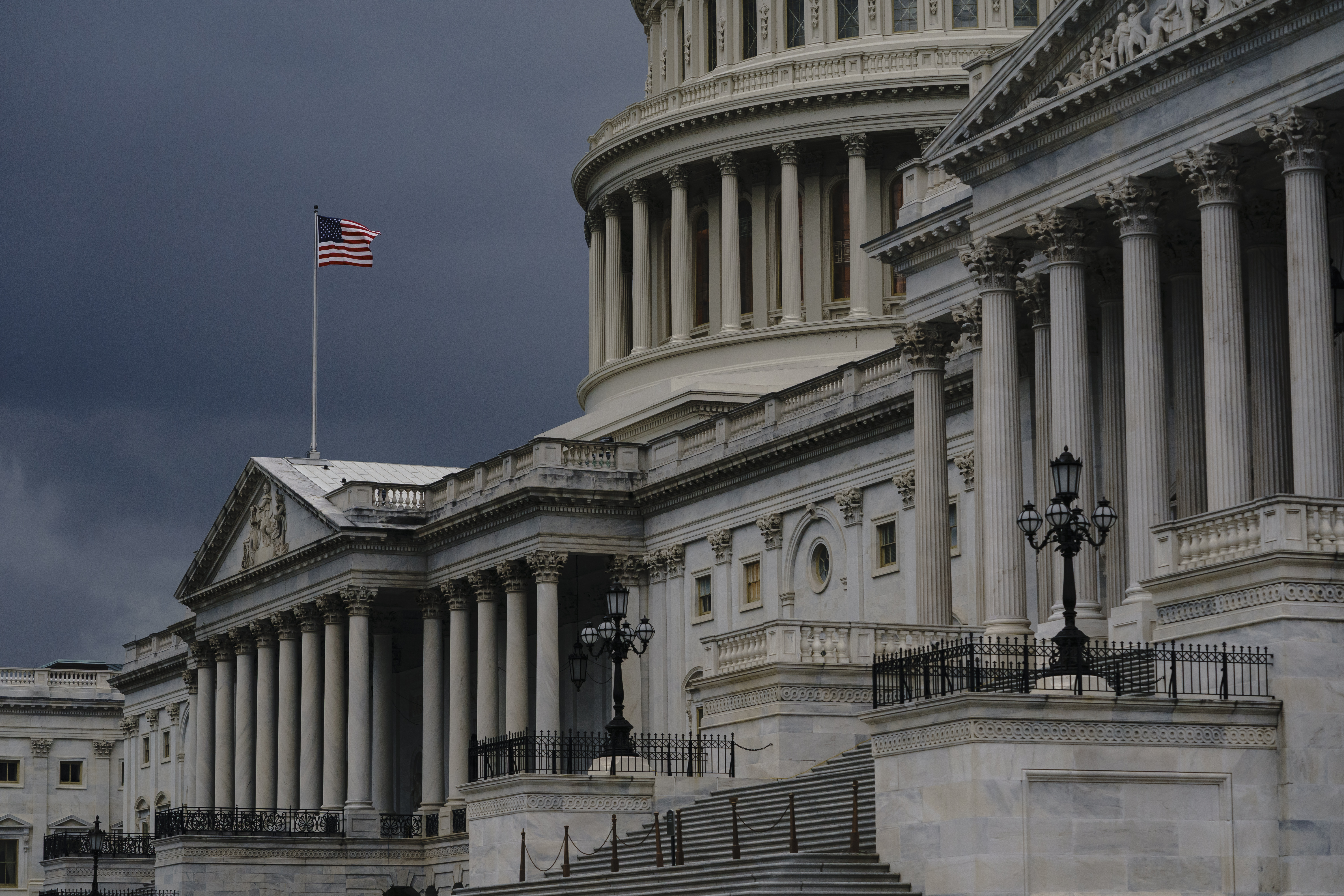 FILE - In this Aug. 3, 2020, file photo dark clouds and heavy rain sweep over the U.S. Capitol in Washington.