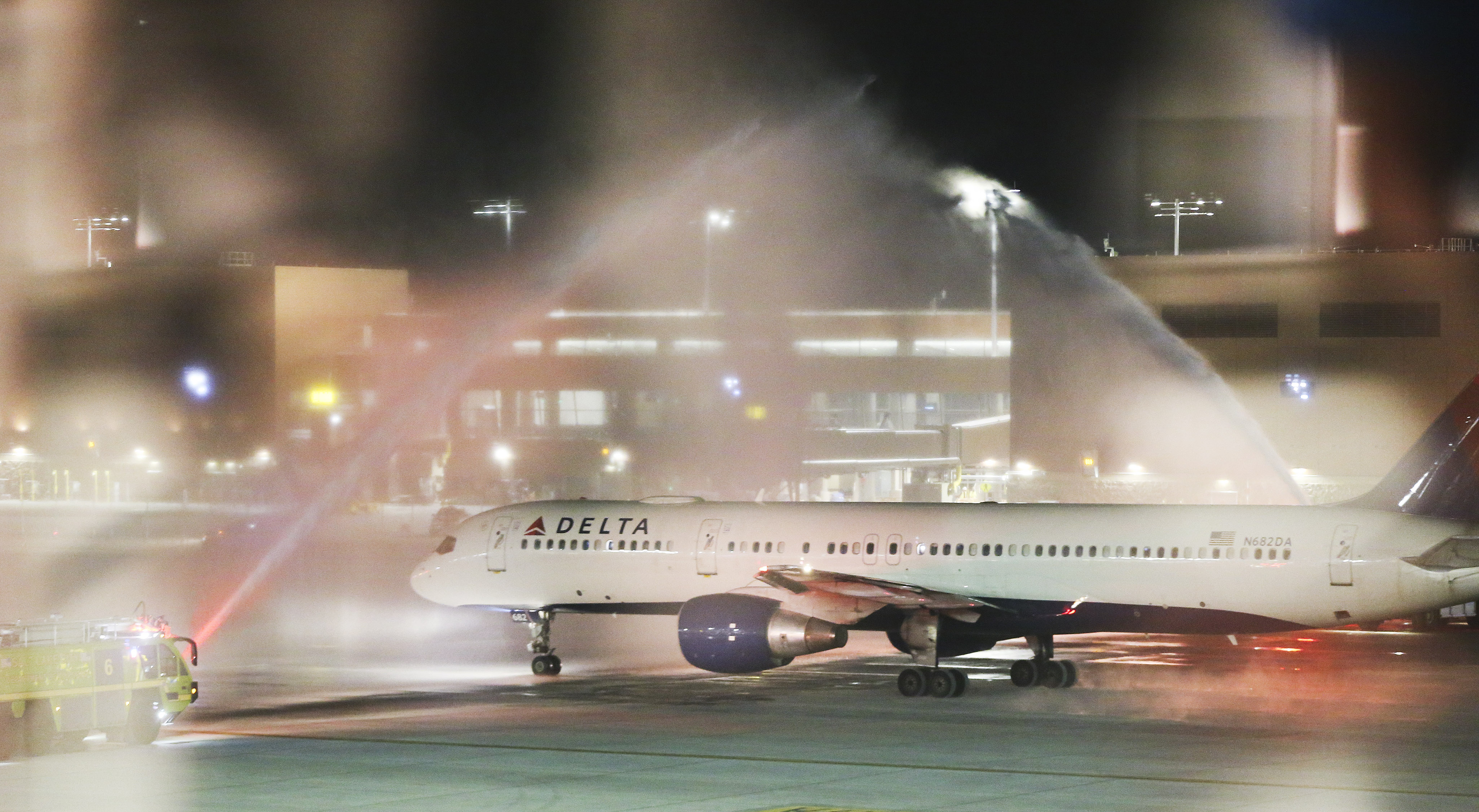 A water cannon salutes the first flight leaving the new Salt Lake City International Airport for Atlanta in Salt Lake City on Tuesday, Sept. 15, 2020. The airport's parking garage, terminal and the west portion of Concourse A are now open.