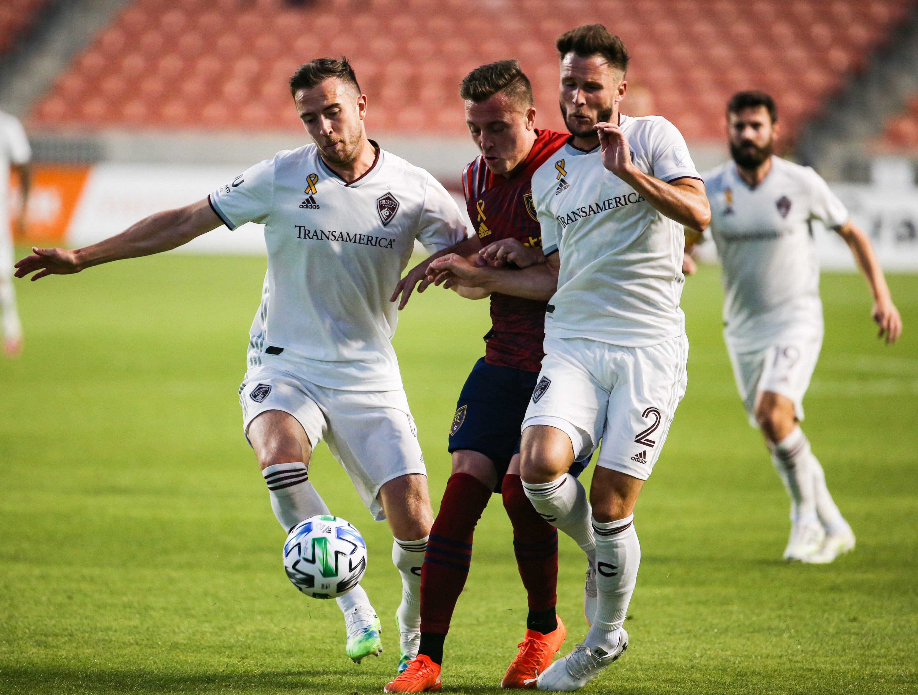 Colorado Rapids defender Danny Wilson (4) and defender Keegan Rosenberry (2) attempt to stop Real Salt Lake forward Corey Baird (10) during an MLS soccer game at Rio Tinto Stadium in Sandy on Saturday, Sept. 12, 2020.