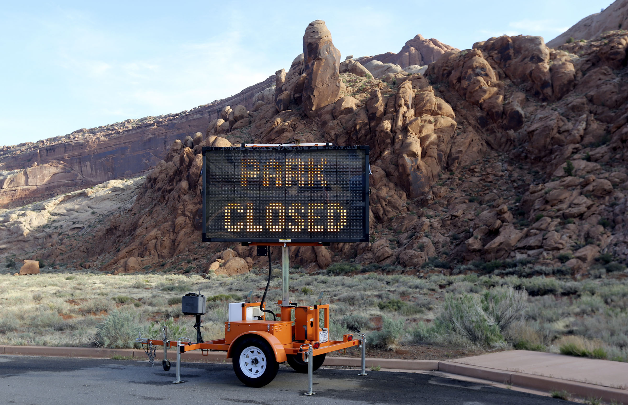 A sign alerts visitors that Arches National Park outside of Moabis closed due to the coronavirus pandemic on Sunday, April 19, 2020.
