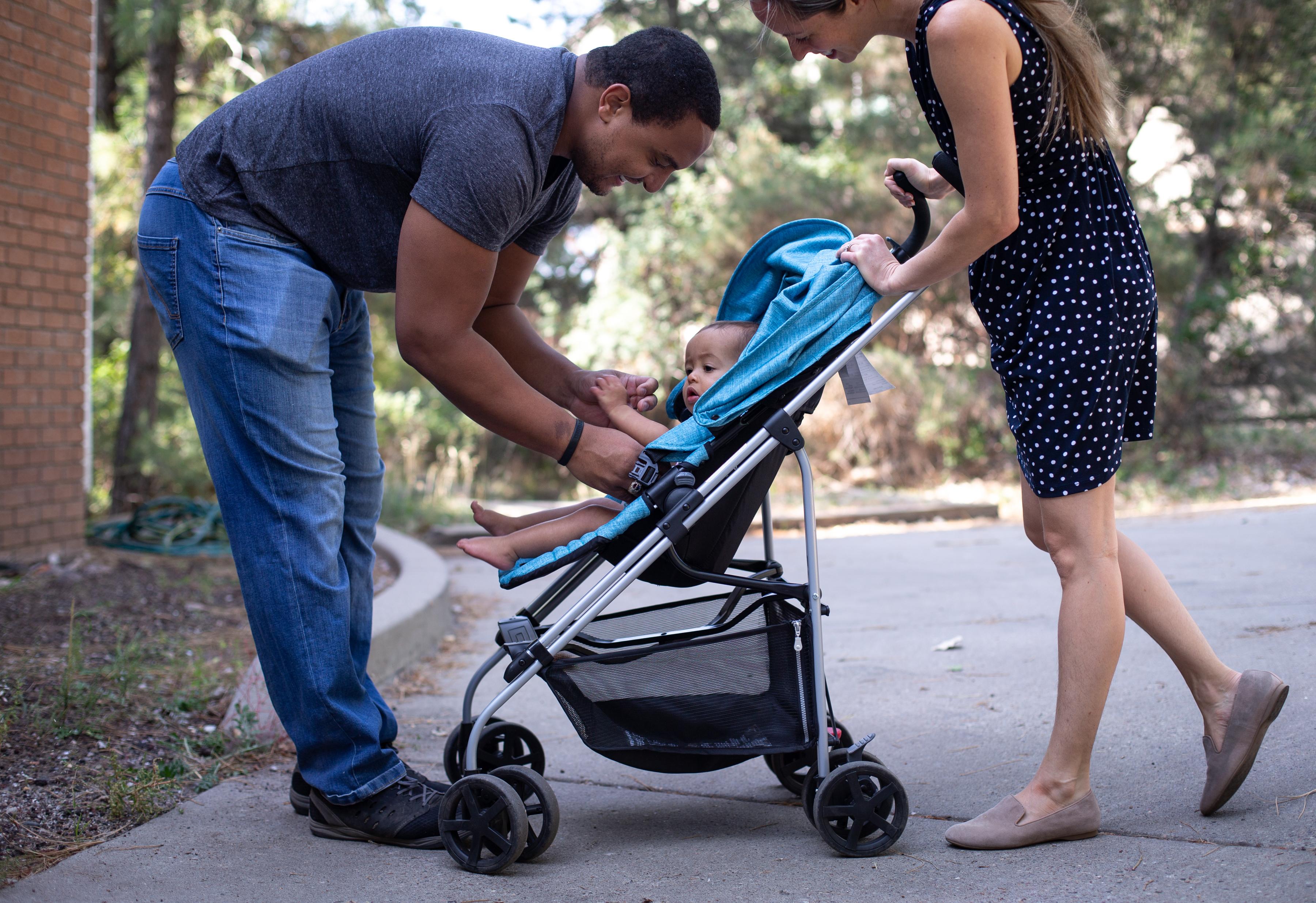 Luke Northam, left, his wife, Emily Schneider, and their daughter, Mira Schneider Northam, walk near their home in Flagstaff, Ariz., on Saturday, Sept. 19, 2020.