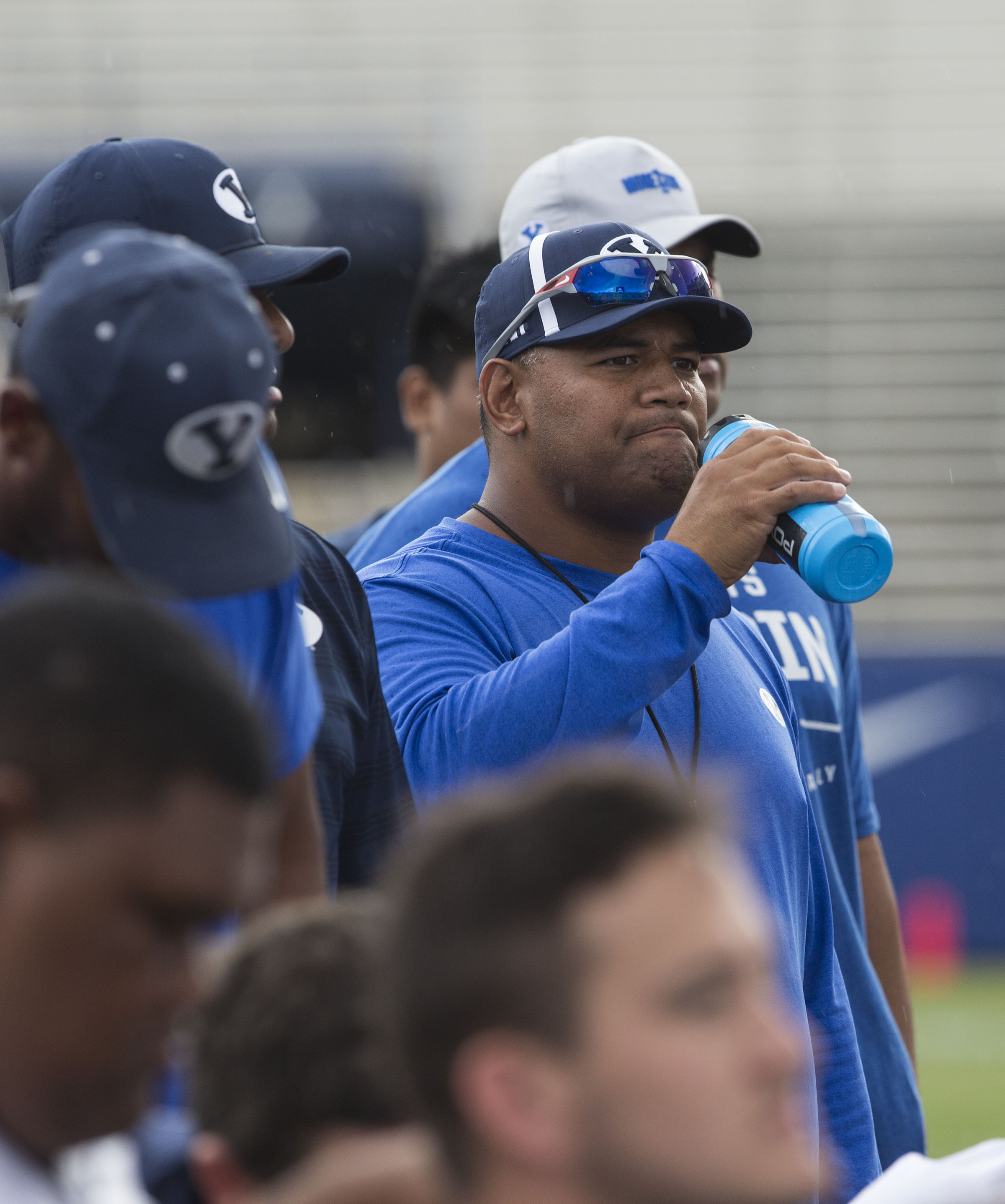 BYU defensive coordinator Ilaisa Tuiaki listens to the post-practice debriefing in Provo on Thursday, August 10, 2017.