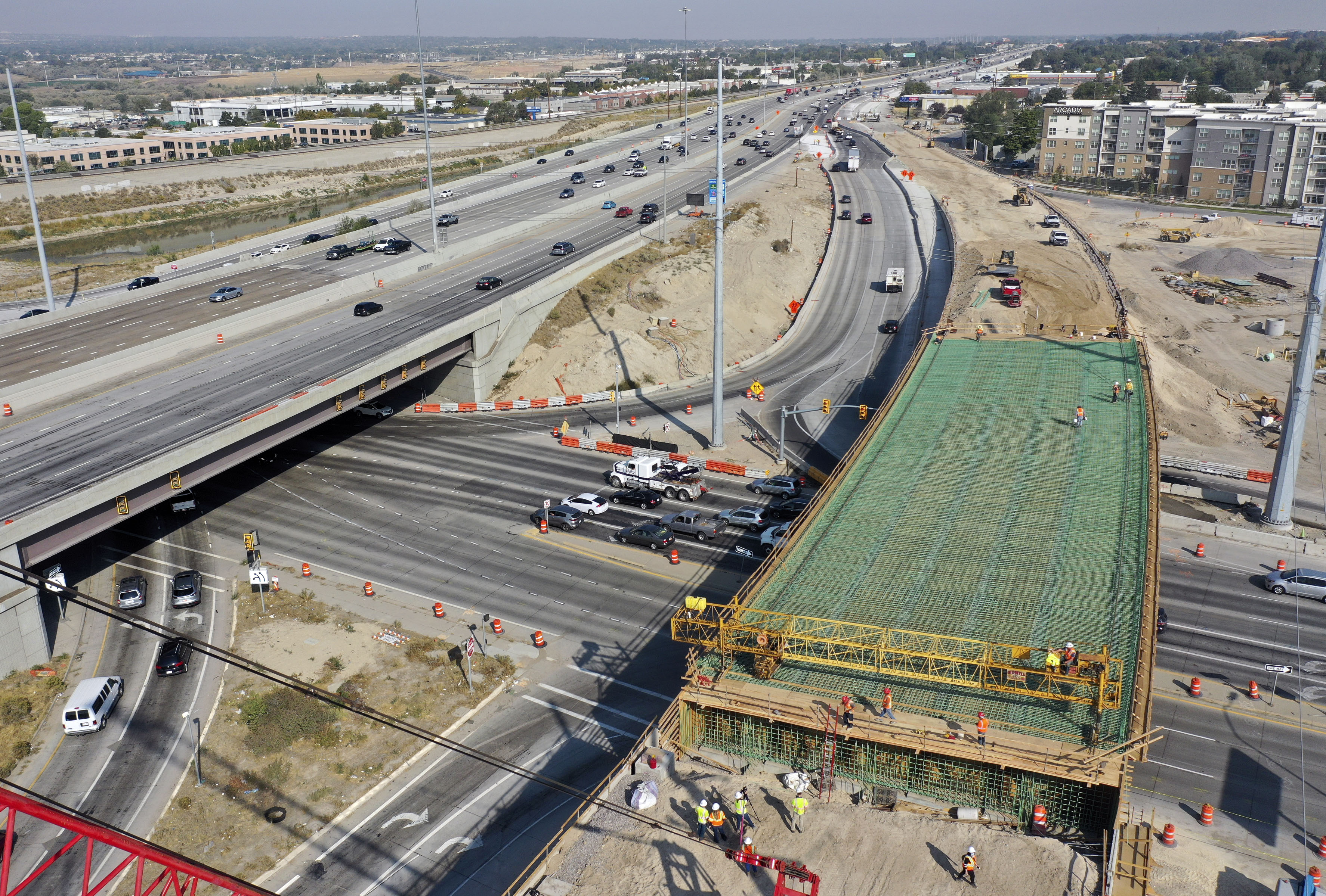 Ames Construction crews work on a new bridge over 9000 South that will be part of the northbound I-15 collector/distributor system in Sandy on Friday, Sept. 25, 2020.The collector/distributor will run parallel to northbound I-15 between 9400 South and the I-215 interchange and will improve access to I-215 and 7200 South.