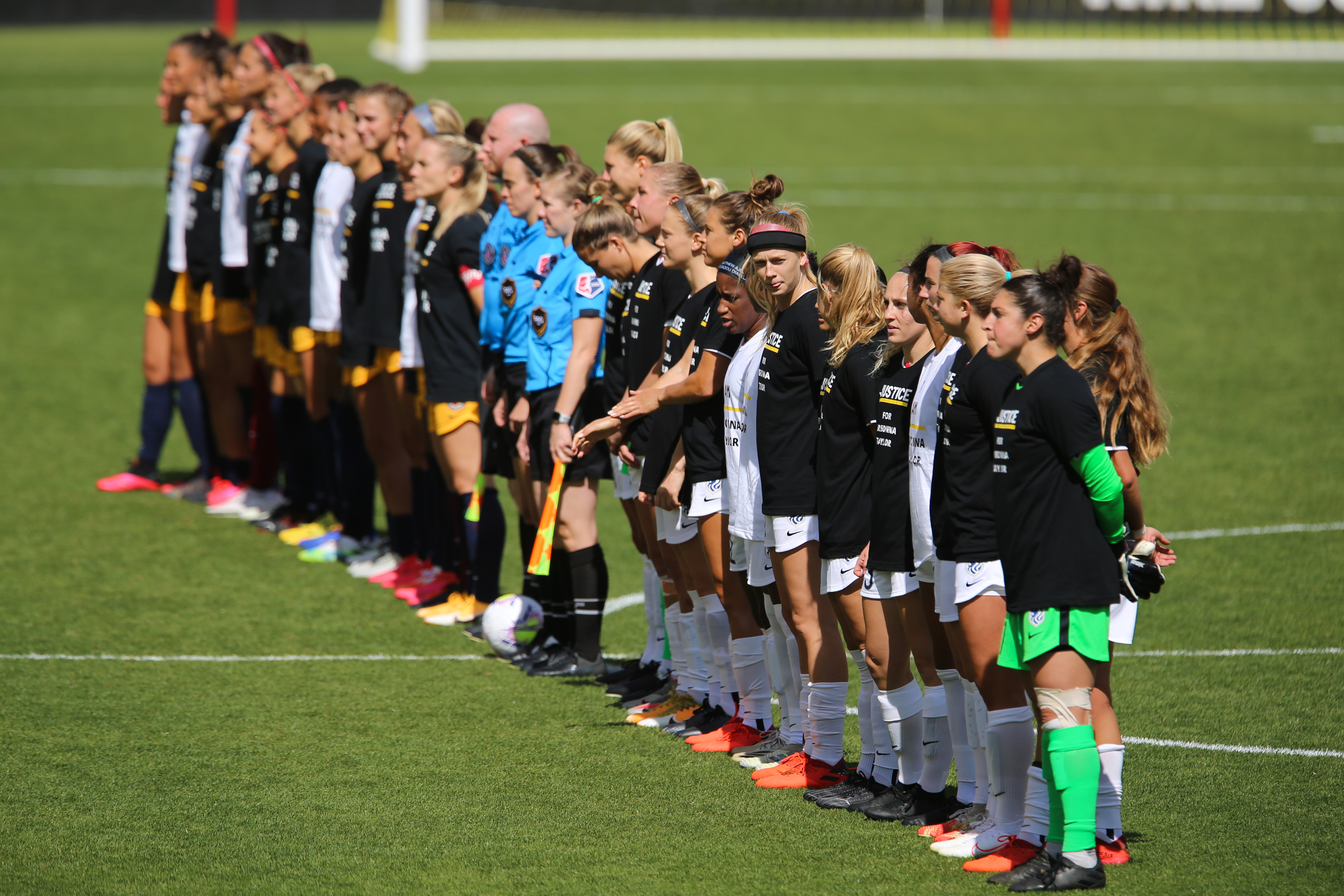 Players from Utah Royals FC and OL Reign FC line up before the start of a NWSL soccer game at Rio Tinto Stadium in Sandy on Saturday, Sept. 26, 2020.