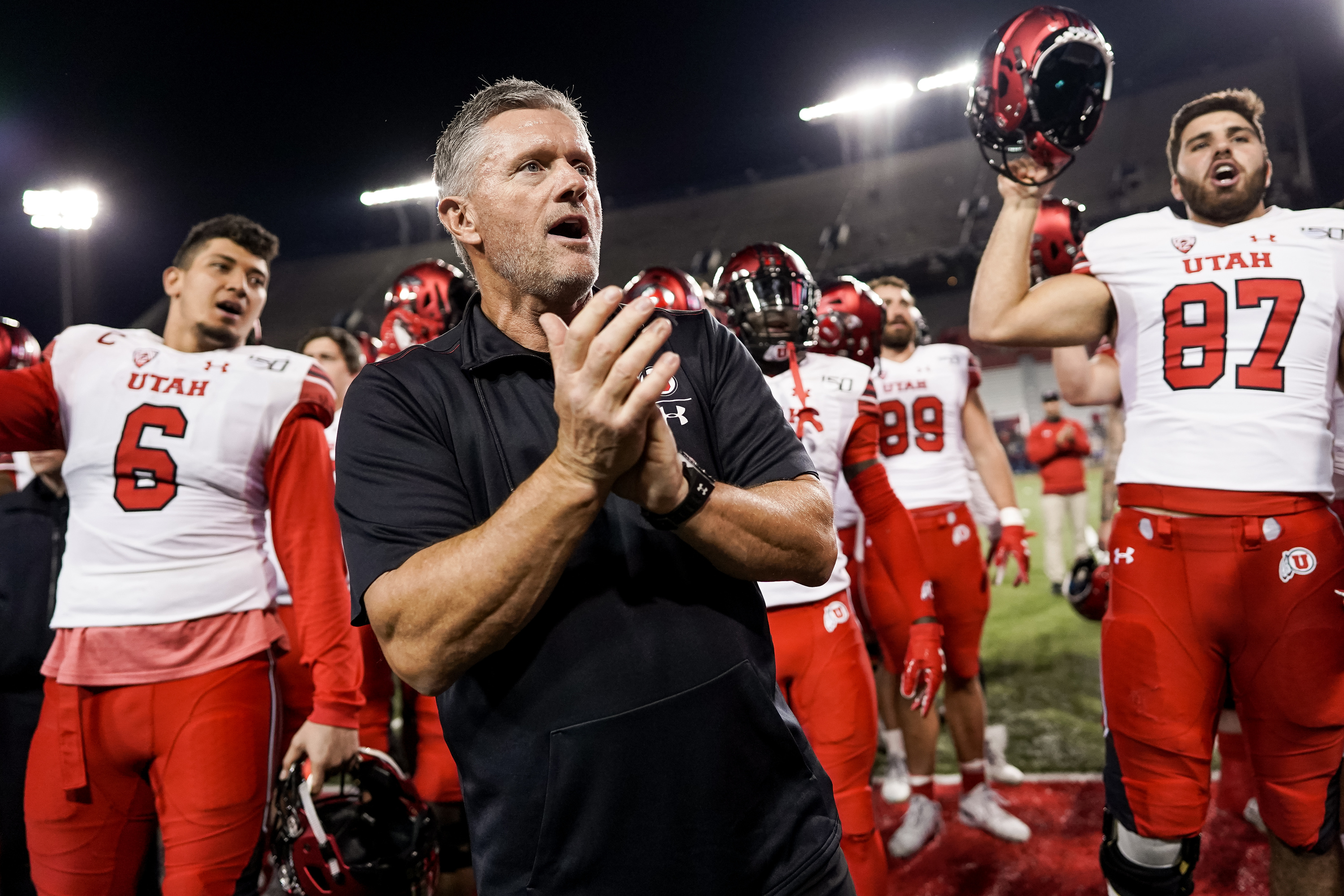 Utah Utes head coach Kyle Whittingham and players celebrate their 35-7 win over the Arizona Wildcats at Arizona Stadium in Tucson, Arizona on Saturday, Nov. 23, 2019.