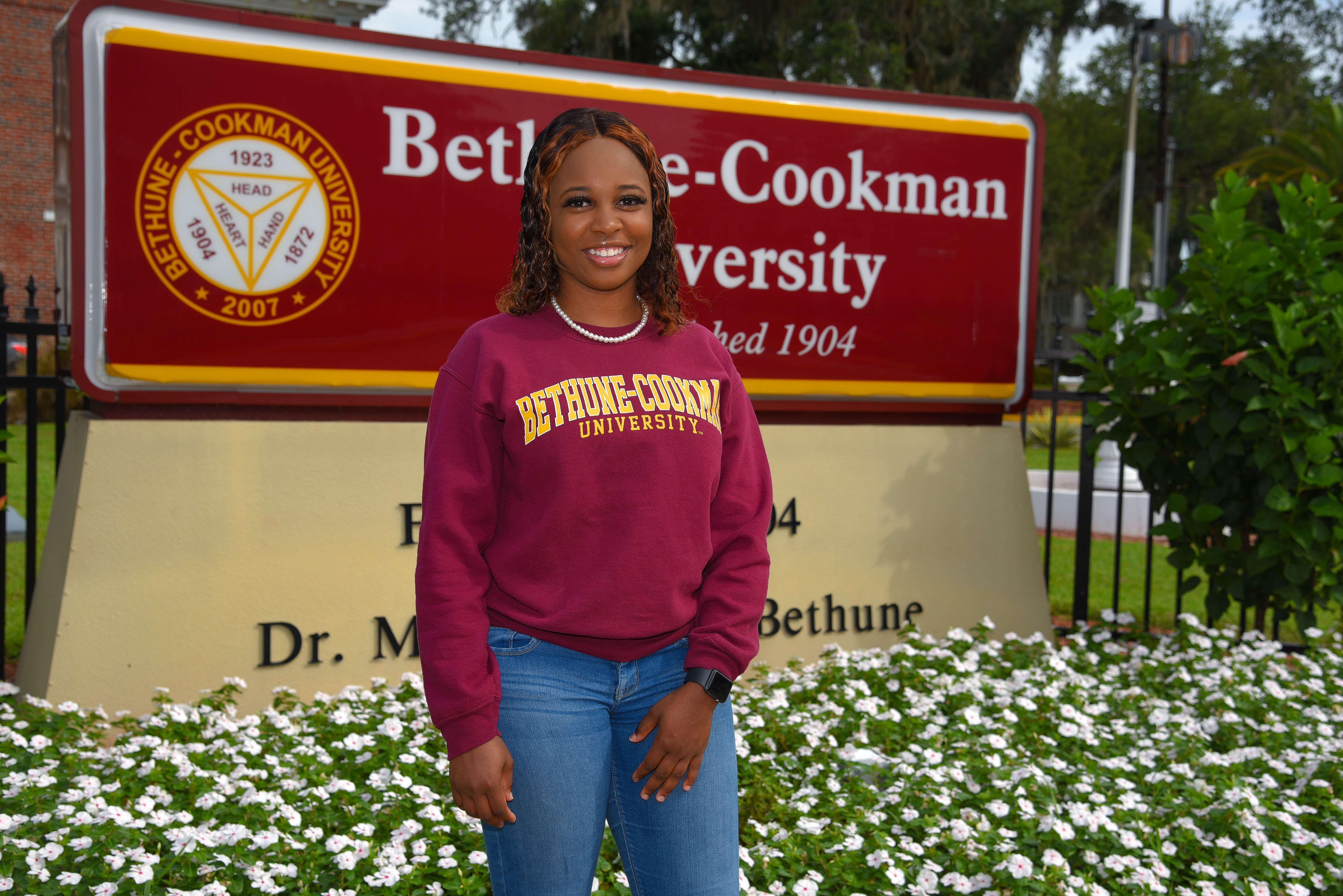 Bethune-Cookman University student Gege Baptiste poses for a portrait on campus in Daytona Beach, Fla., on Aug. 21, 2020. Baptiste is Haitian and, unlike her fellow college and university students, can't receive federal financial aid because she is on temporary protected status.