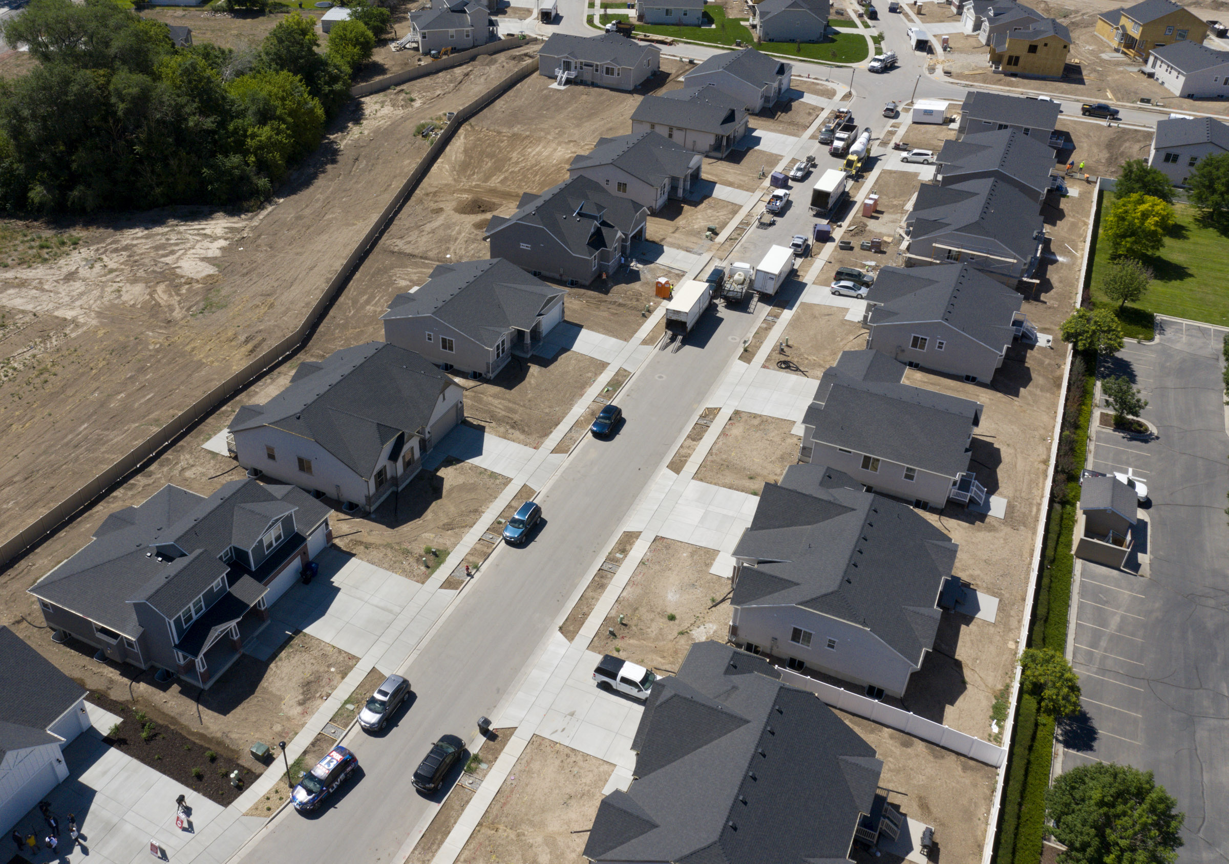 Homes near completion at C.W. Farms, an Ivory Homes development in Magna, on July 29, 2020. The Salt Lake City metro area is the third-most competitive housing market in the nation, according to a July ranking by Redfin, behind only Boston and San Diego. Robert Spendlove, Zions Bank senior economist, and Mike Gould, mortgage division manager for Zions Bancorporation, talked about the current state of and outlook for Utah's housing market during a press conference at the new subdivision.