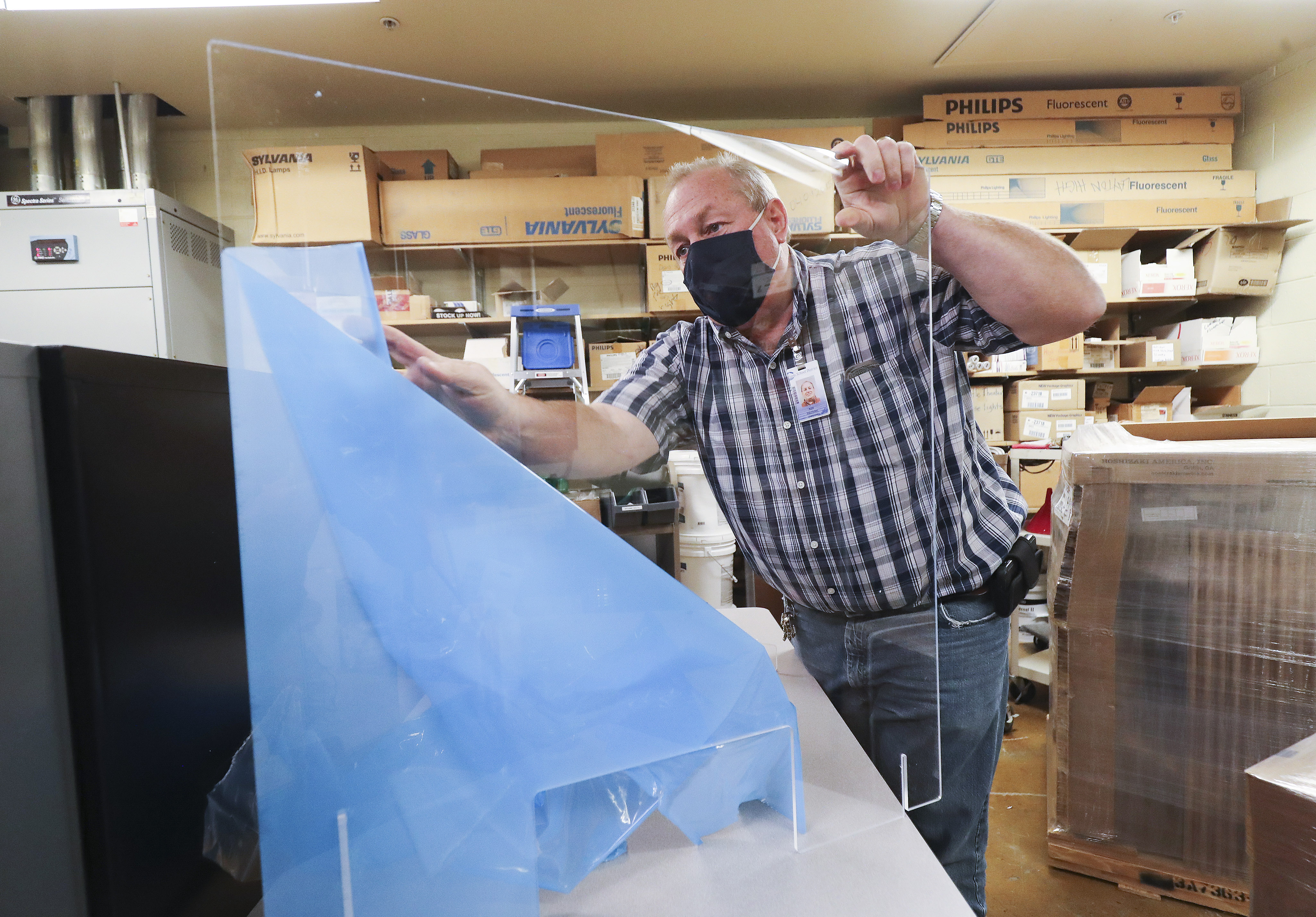 Layton High School facilities coordinator Rod Southam unpacks portable desk shields at the school in Layton on Tuesday, Sept. 29, 2020. Southam is the winner of the national U.S. Department of Education RISE award, which honors classified school employees who exemplify excellence in work performance, leadership and community involvement.