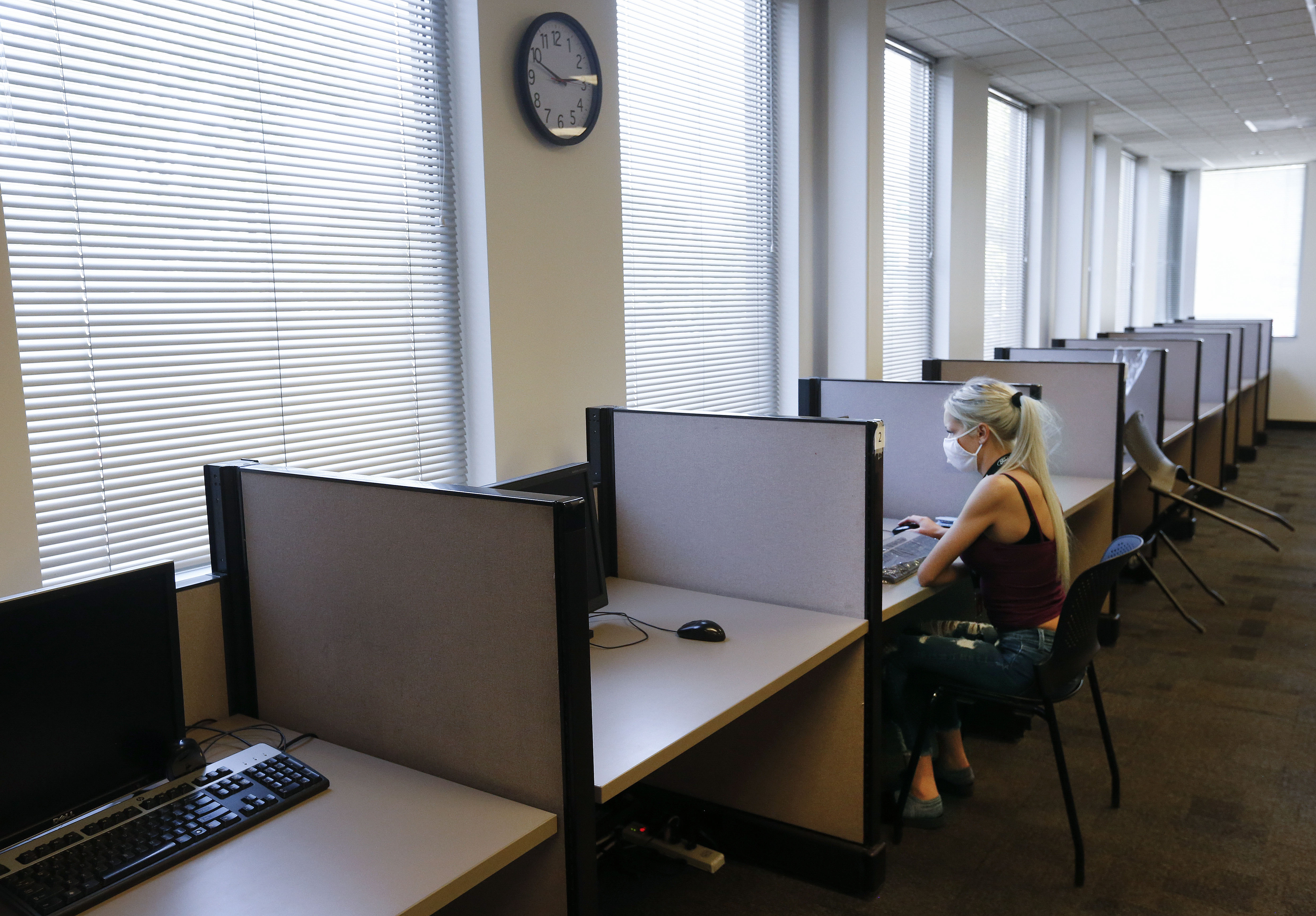 Ellie Newbold, of Tooele, searches for jobs at the Utah Department of Workforce Services in Taylorsville on Wednesday, Sept. 16 2020.