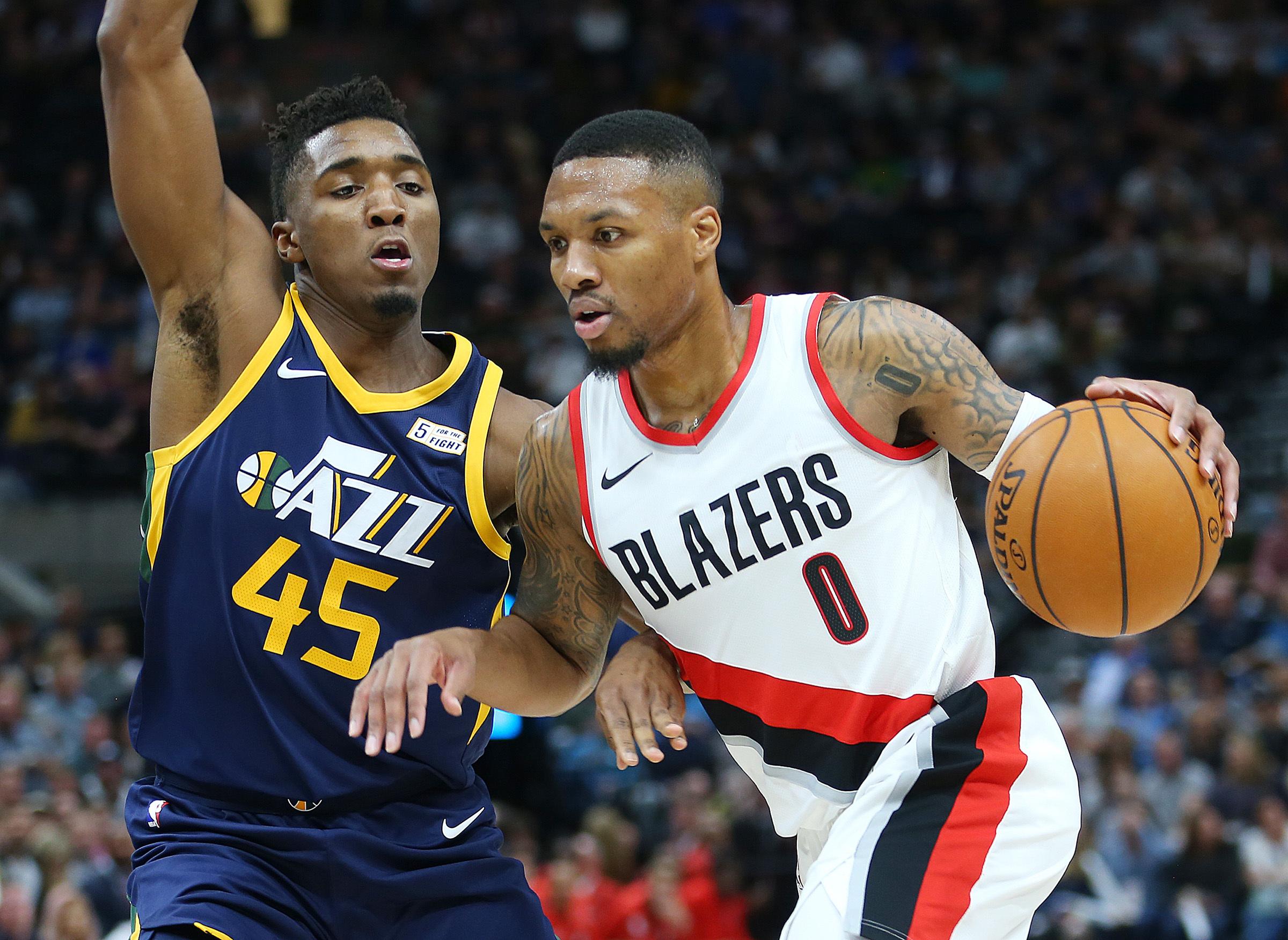 Utah Jazz guard Donovan Mitchell (45) defends Portland Trail Blazers guard Damian Lillard (0) as the Utah Jazz and the Portland Trailblazers play at Vivint Arena in Salt Lake City on Wednesday, Nov. 1, 2017.