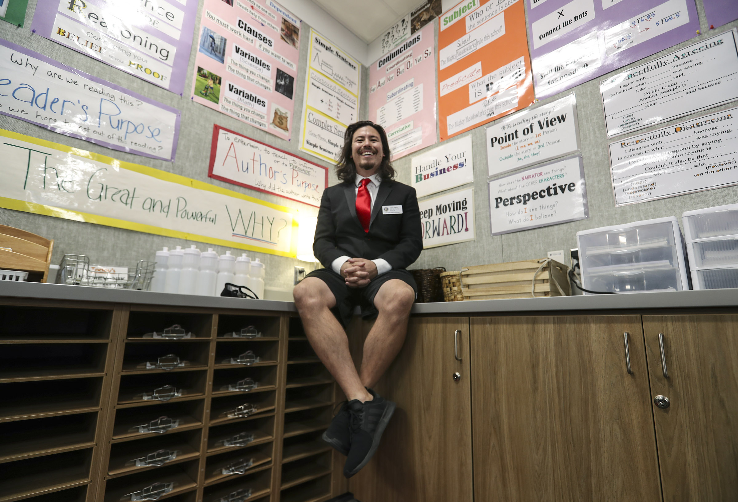 John Arthur, Utah's Teacher of the Year, wears a special punk tuxedo jacket and gym shorts as he poses for a photo in his sixth grade classroom at Meadowlark Elementary School in Salt Lake City after learning of the award on Thursday, Oct. 1, 2020.