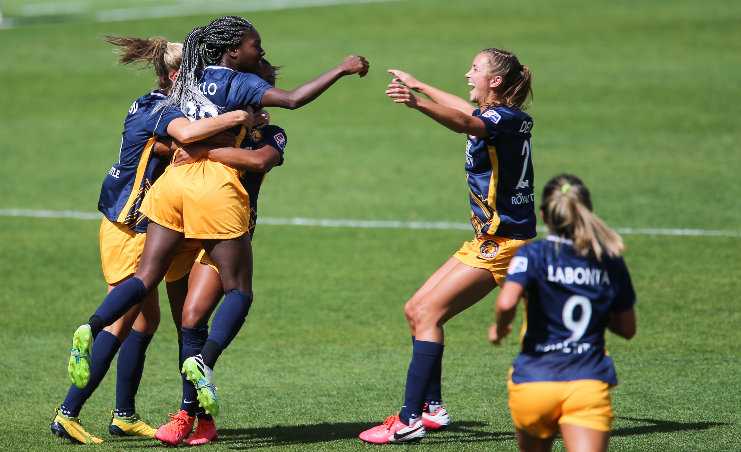 Utah Royals FC players celebrate as Aminata Diallo (38) scores the first goal during a NWSL soccer game at Rio Tinto Stadium in Sandy on Saturday, Sept. 26, 2020.