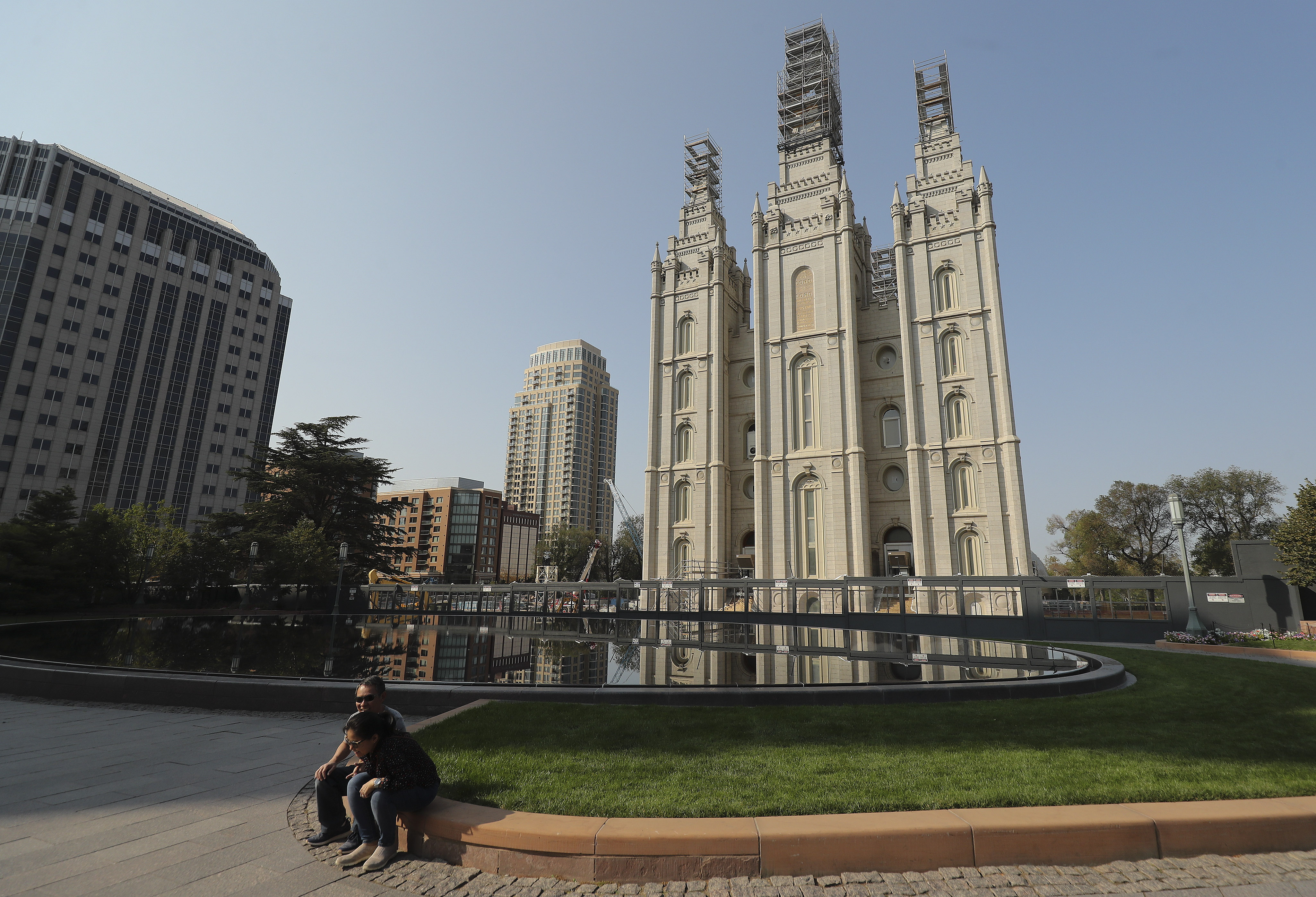 Visitors sit near the Salt Lake Temple during the 190th Semiannual General Conference of The Church of Jesus Christ of Latter-day Saints in Salt Lake City on Saturday, Oct. 3, 2020.