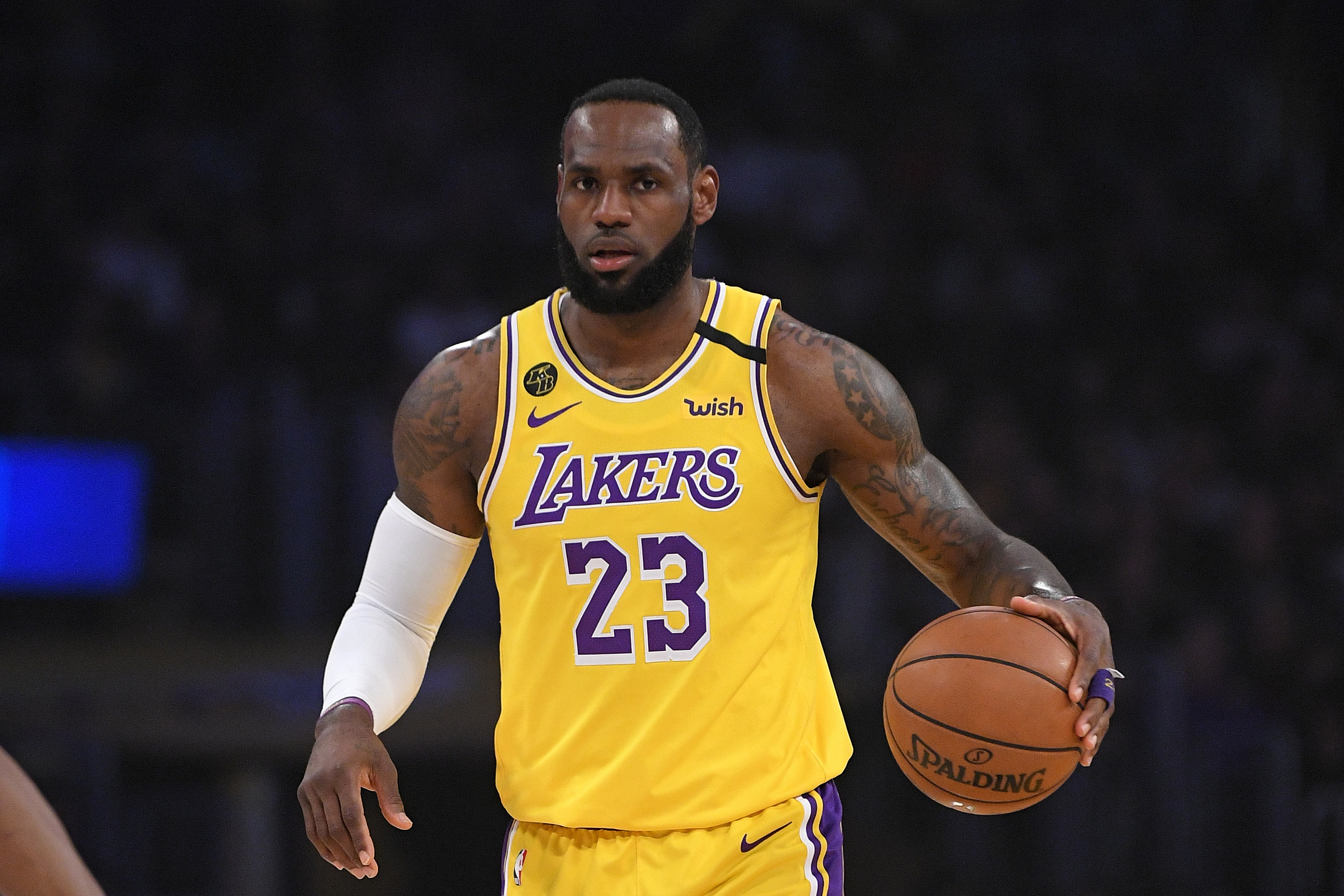 Los Angeles Lakers forward LeBron James dribbles during the first half of an NBA basketball game against the Philadelphia 76ers Tuesday, March 3, 2020, in Los Angeles. (AP Photo/Mark J. Terrill)