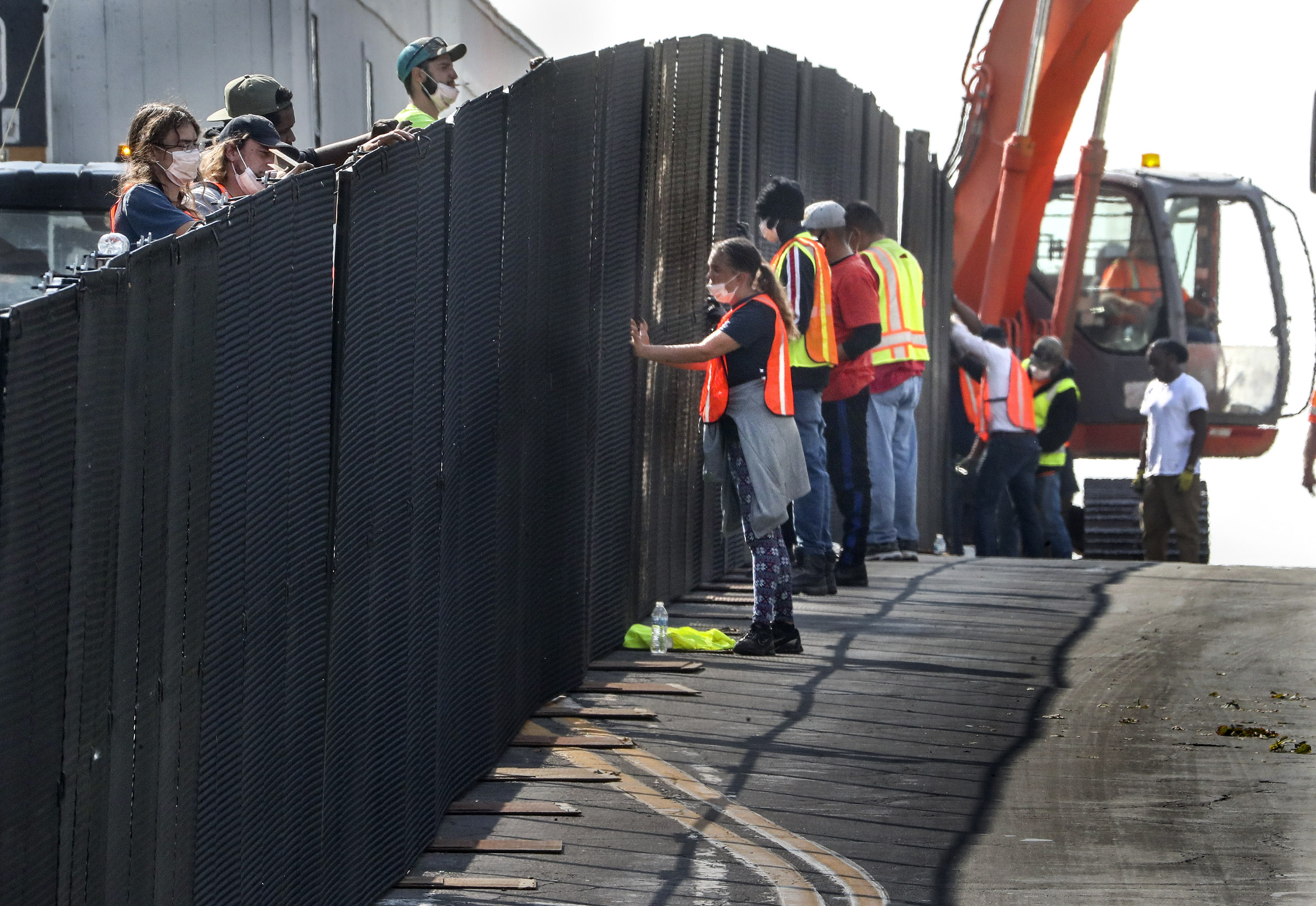 Crews work to build a barrier fence along University Street in front of President's Circle near 100 South prior to the vice presidential debate in Kingsbury Hall on the University of Utah campus in Salt Lake City on Monday, Oct. 5, 2020. The debate between Vice President Mike Pence and Sen. Kamala Harris, the Democratic nominee for vice president, is scheduled for Wednesday.