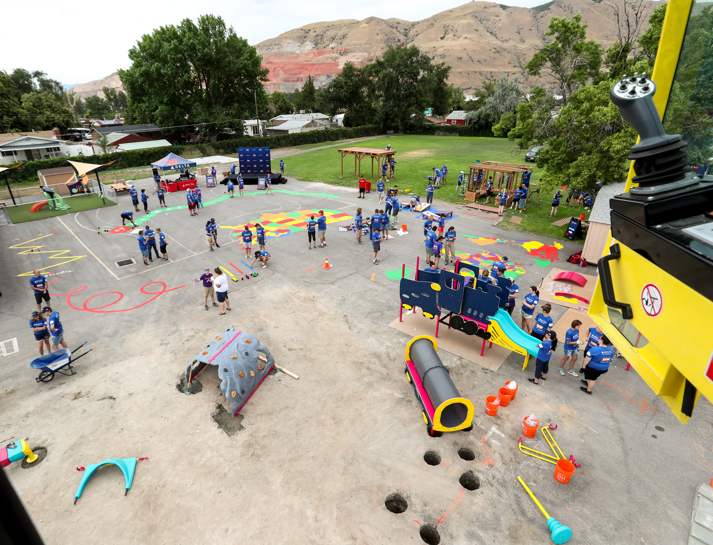 Volunteers transform an empty site into a kid-designed, state-of-the-art playground at James R. Russell Head Start in Salt Lake City in 2018. A new study notes that while Utah does have several programs to help with a child's mental well-being such as Head Start, overall the state lacks enough resources focused on children's mental health.