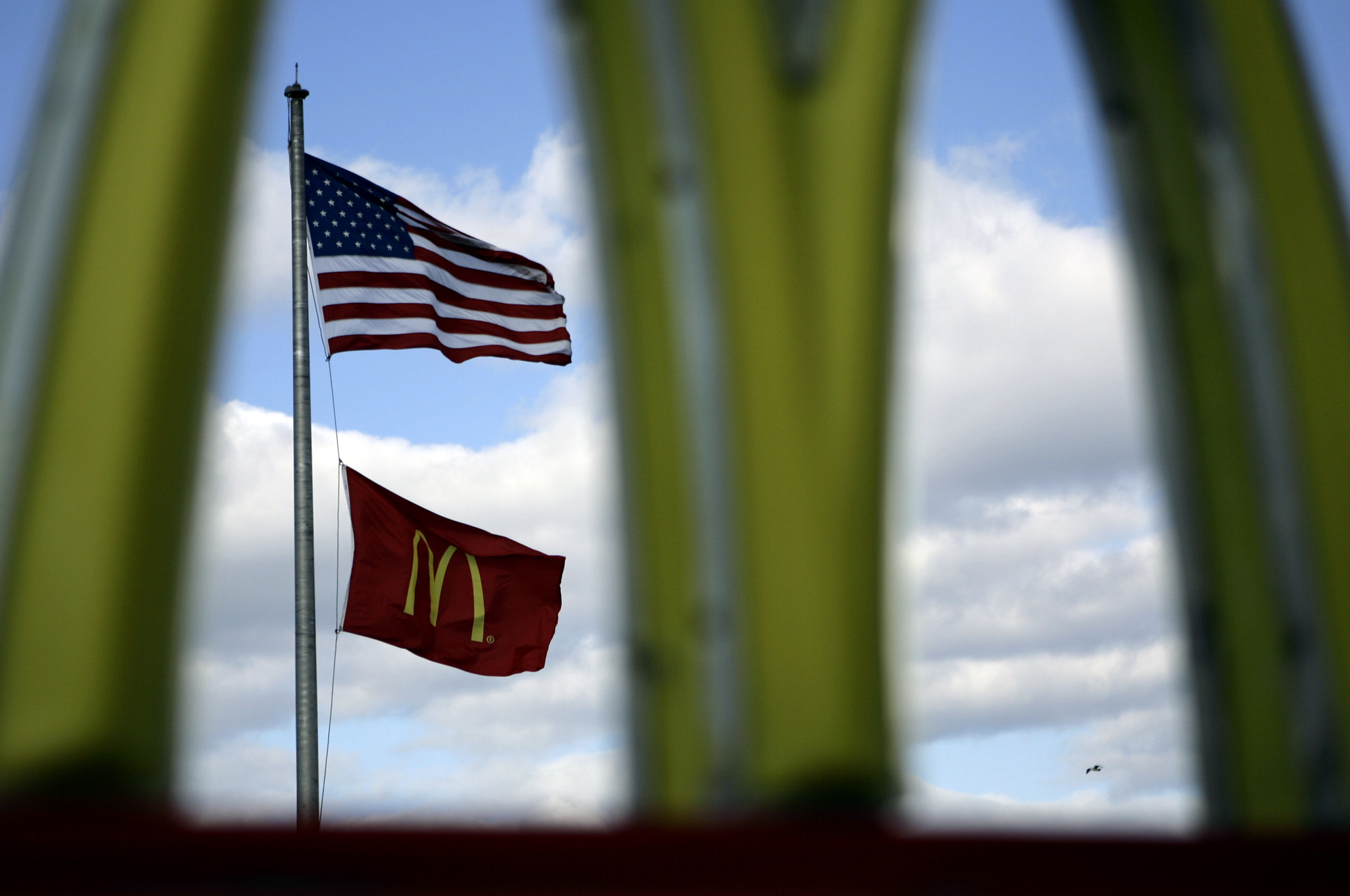 A McDonald's flag and a logo are seen outside one of the company's restaurants on Chicago's near North Side, Thursday, Oct. 12, 2006. Newly released data from QSR magazine showed which American fast-food chains were most successful in 2019.