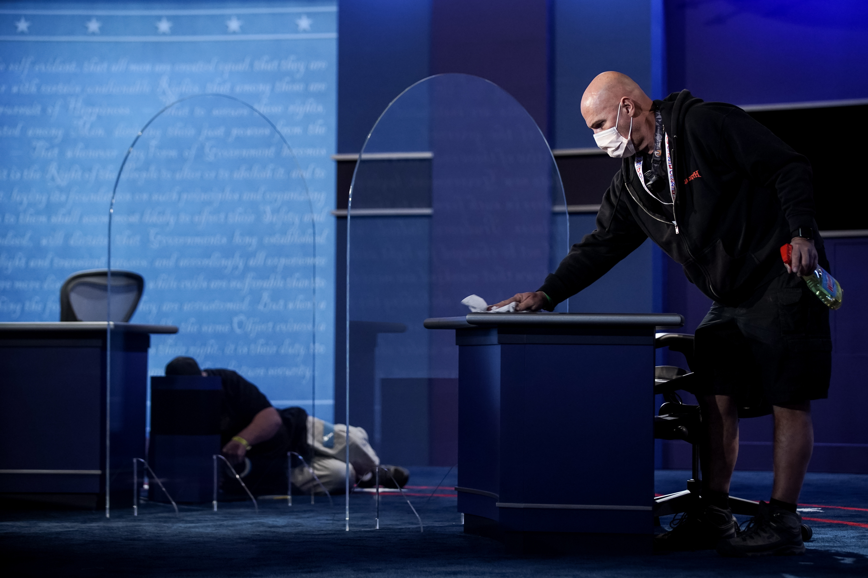 Crew members put the final touches on the stage, which now includes plexiglass partitions, at Kingsbury Hall at the University of Utah in Salt Lake City on Tuesday, Oct. 6, 2020, in preparation for Wednesday's vice presidential debate.