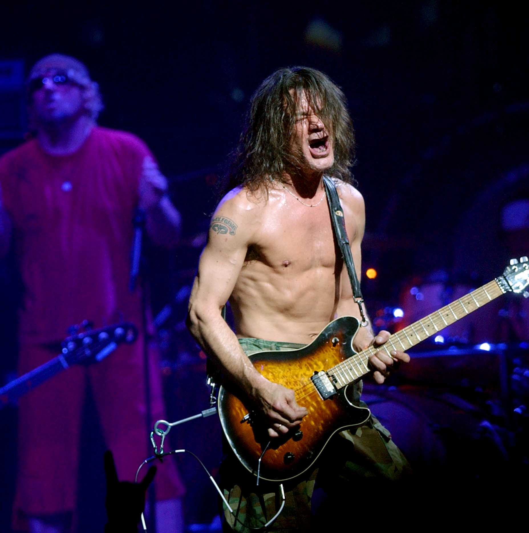Eddie Van Halen performs with his band, Van Halen at the Delta Center, Aug. 3, 2004 in Salt Lake City Utah.