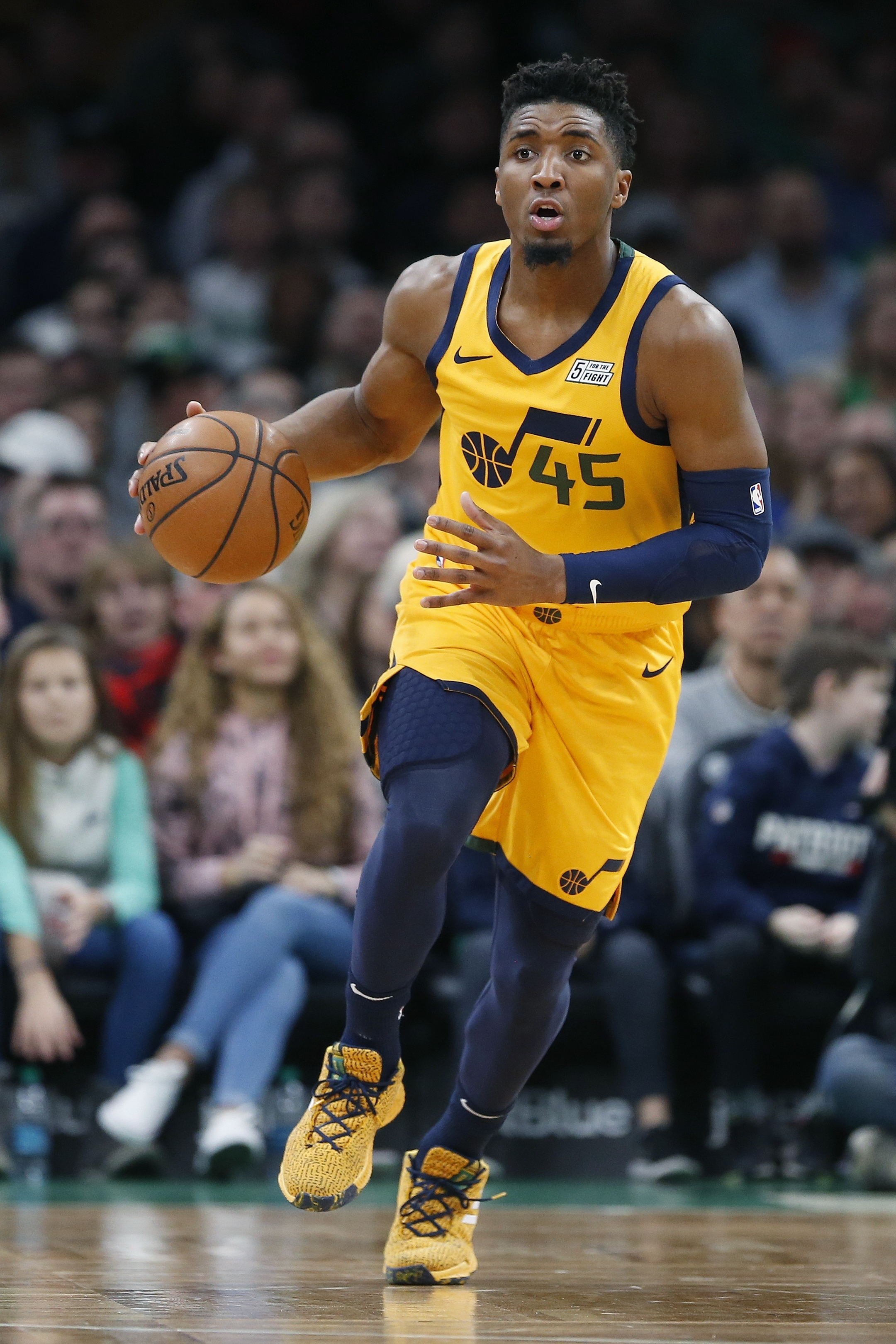 Utah Jazz's Donovan Mitchell (45) plays against the Boston Celtics during the first half on an NBA basketball game in Boston, Saturday, Nov. 17, 2018. (AP Photo/Michael Dwyer)