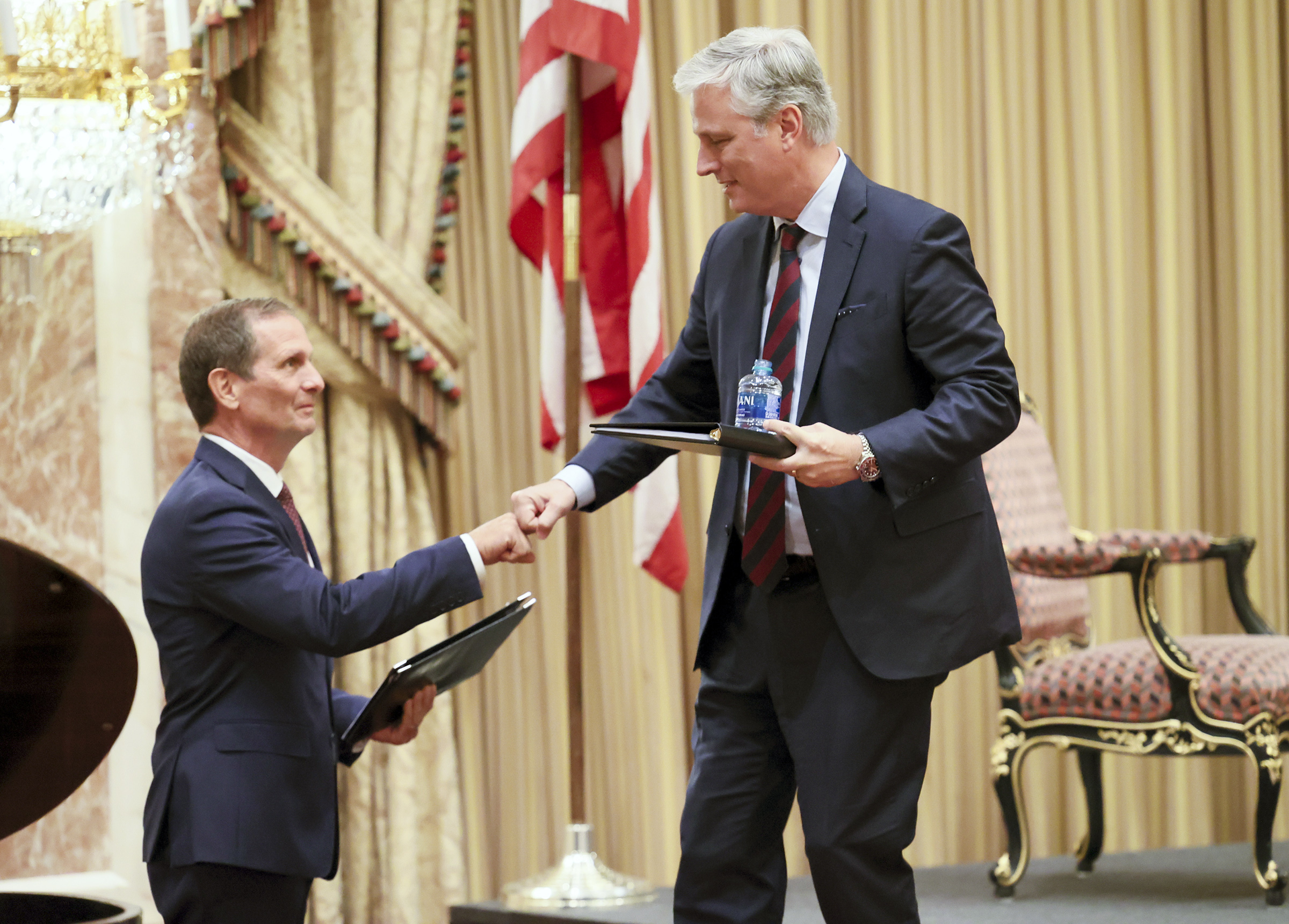 Rep. Chris Stewart, R-Utah, left, shakes hands with U.S. national security adviser Robert O'Brien after O'Brien gave the keynote address at the 6th annual Stewart Security Summit at the Grand America Hotel in Salt Lake City on Tuesday, Oct. 6, 2020.
