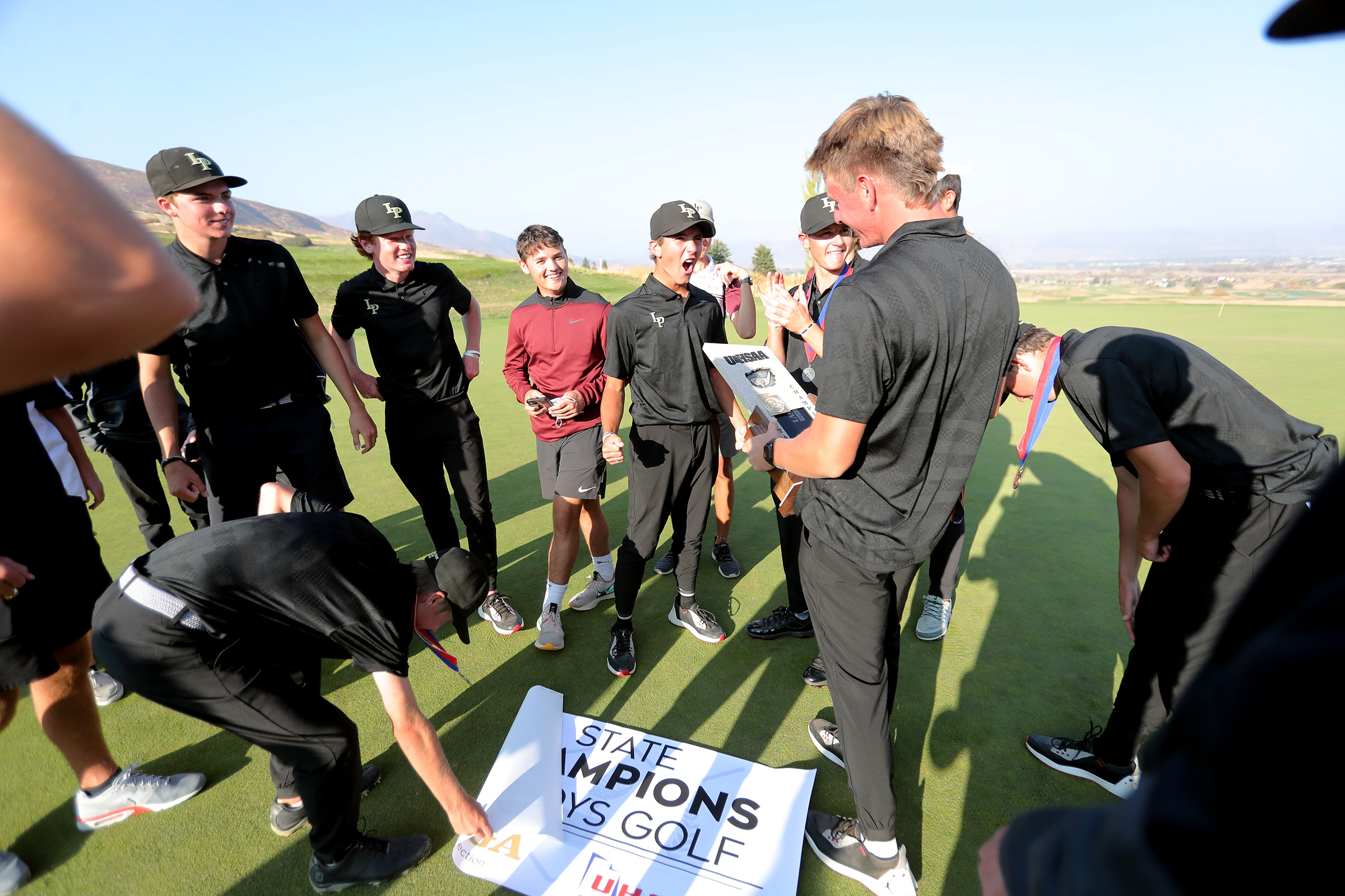 Lone Peak golfers celebrate their 6A state championship at Soldier Hollow in Midway on Tuesday, Oct. 6, 2020.