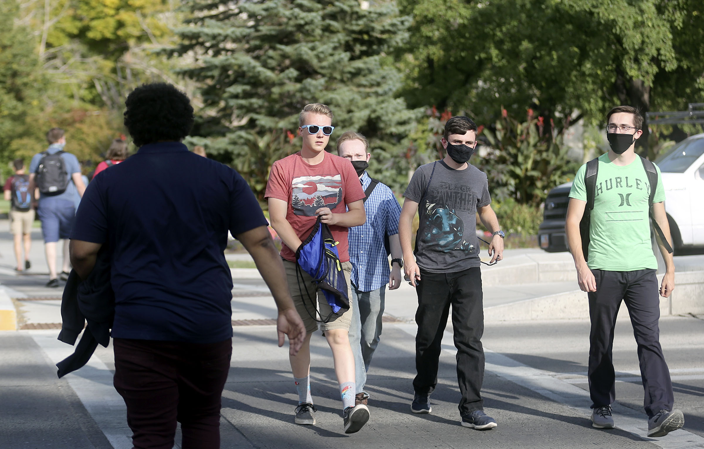 Alex Preston, Thomas Williams, Ben Johnson and Caelen Miller cross University Avenue in downtown Provo on Monday, Sept. 14, 2020. The majority of recent COVID-19 cases are among people between the ages 14-24, many of them living in Utah County.
