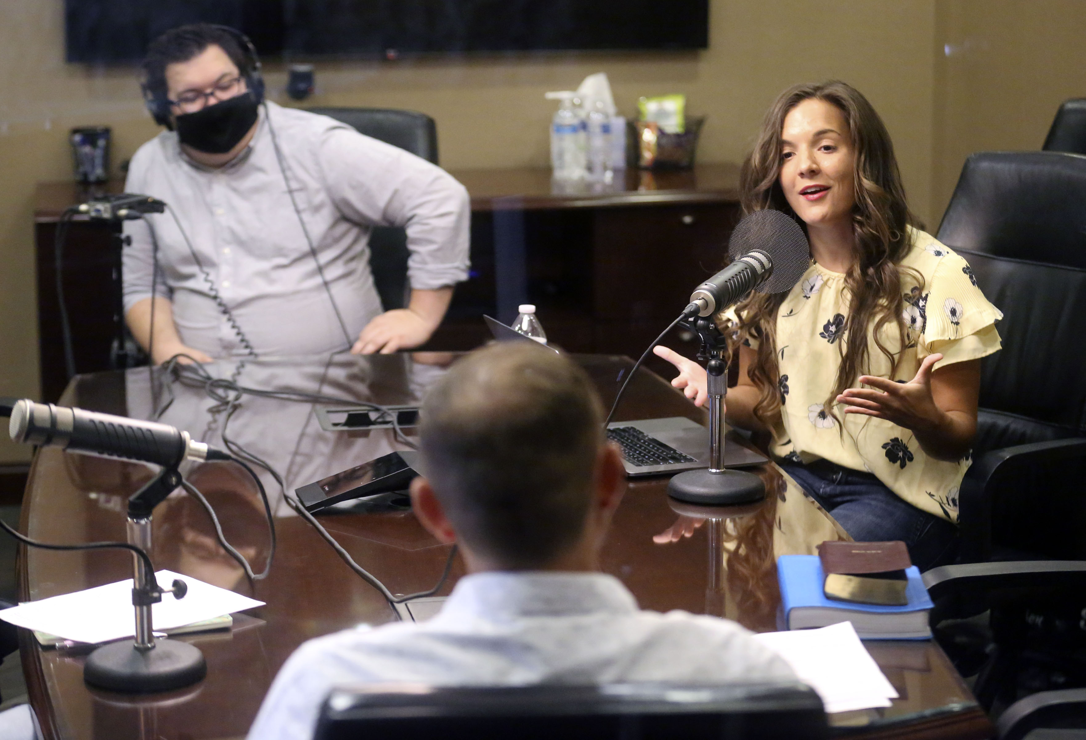 """Host and producer Morgan Jones, right, talks with guest Eric Dyches while recording an episode of """"All In: An LDS Living Podcast"""" at Sorenson Capital in Lehi on Friday, Sept. 25, 2020. Derek Campbell, sound engineer, is on the left."""