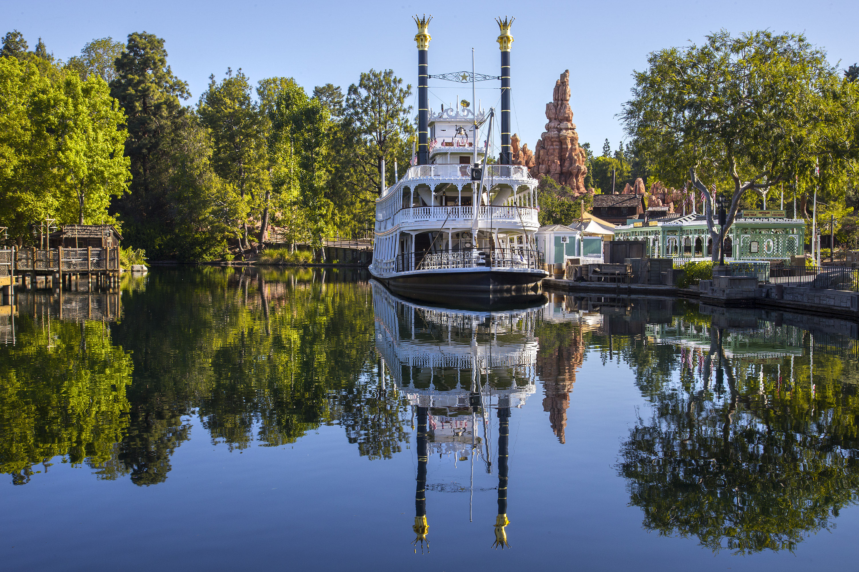 The Mark Twain Riverboat and Big Thunder Mountain are reflected in the Rivers of America in Frontierland at Disneyland Park in Anaheim, Calif. Frontierland brings to life the natural beauty, excitement and promise of the American West in the 1800s. For editorial news use only.