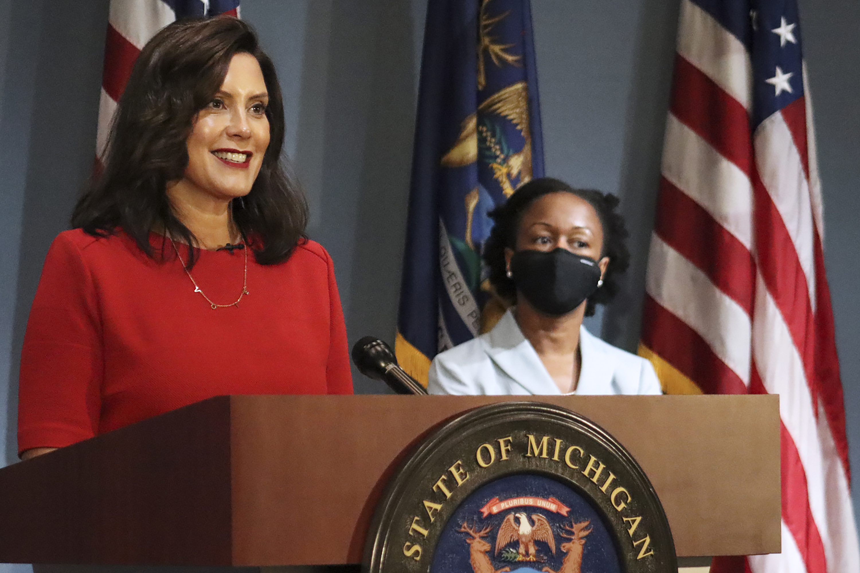 In this photo Sept. 16, 2020 file photo, provided by the Michigan Office of the Governor, Gov. Whitmer addresses the state during a speech in Lansing, Mich. According to a criminal complaint unsealed Thursday, Oct. 8 six people plotted to try to kidnap Whitmer at her vacation home.