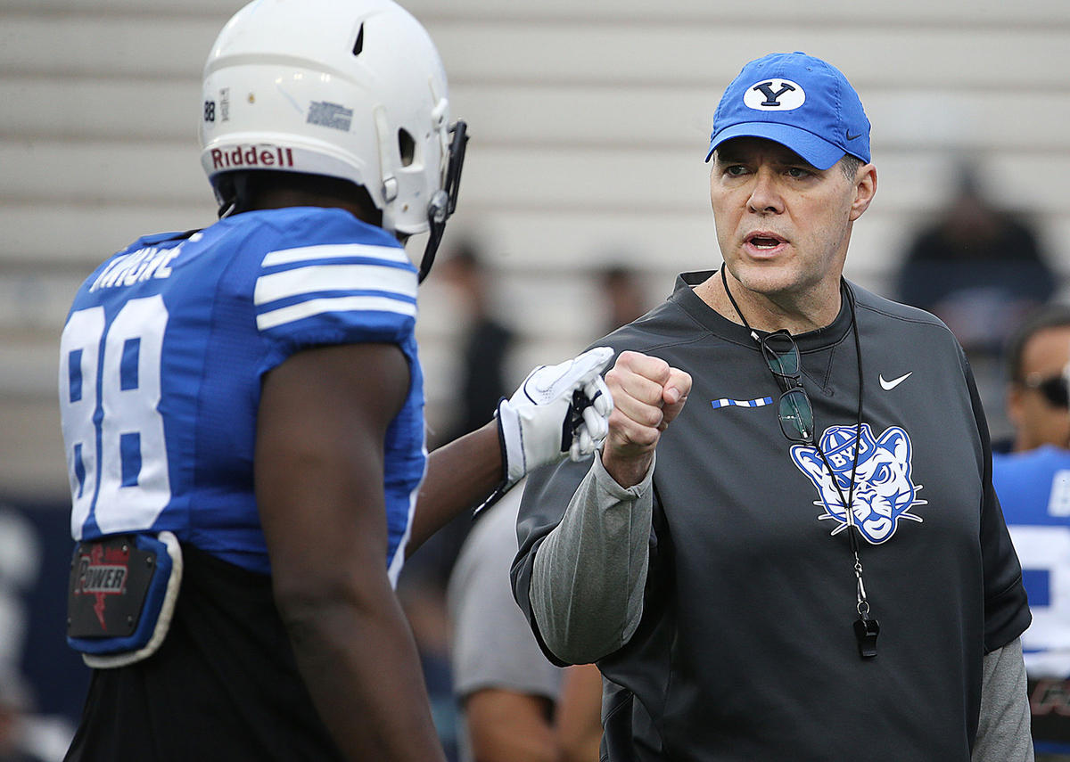 Offensive coordinator Jeff Grimes coaches player during Blue-White game at LaVell Edwards Stadium in Provo on Saturday, April 7, 2018. Grimes spent the first 30 years of his life in Texas and still considers it home. As such, he's well familiar with the toughness Texas teams exhibit.