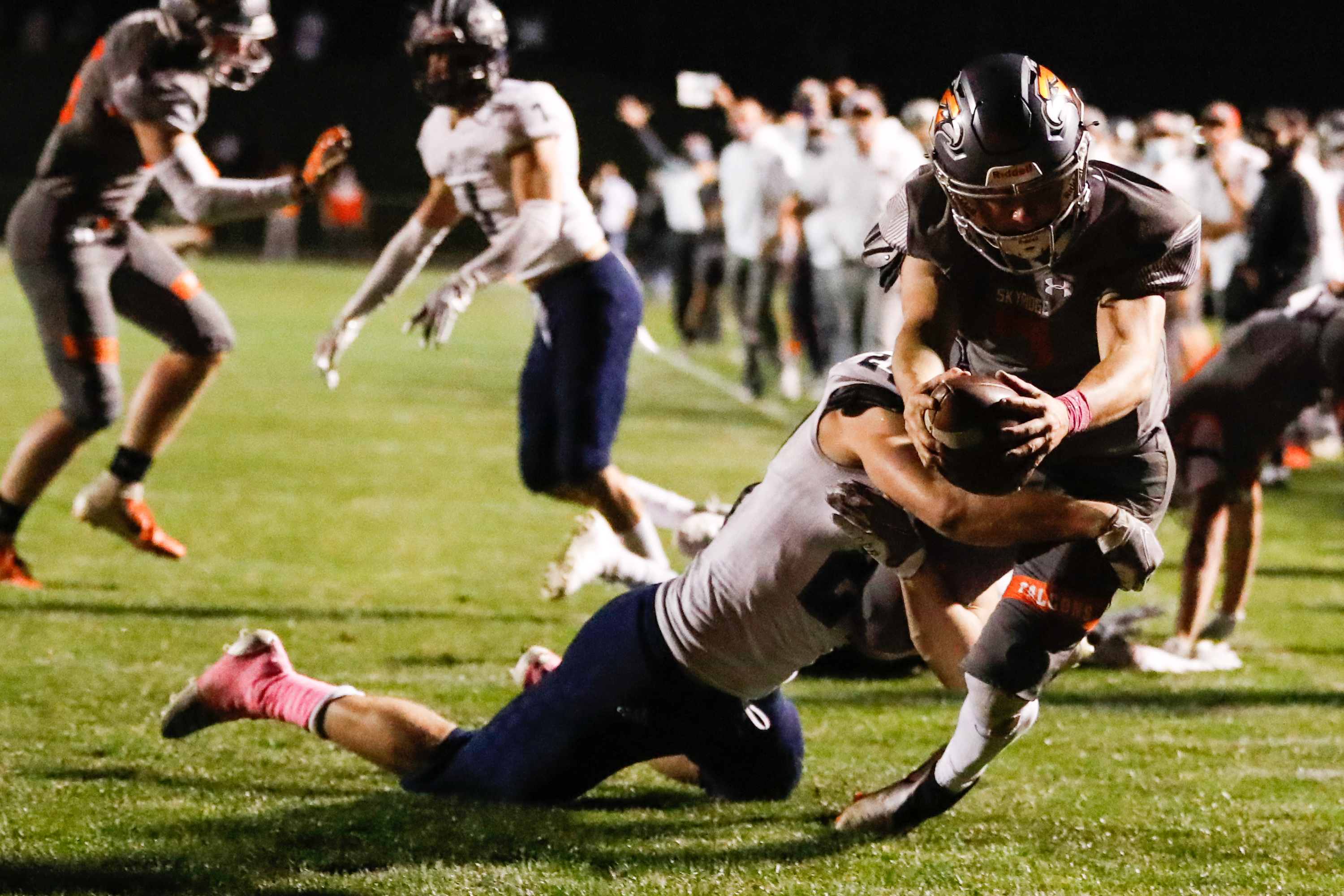 Skyridge's McCae Hillstead (7) carries the ball into the end zone for a touchdown during a high school football game against Corner Canyon at Skyridge High School in Lehi on Thursday, Oct. 8, 2020.