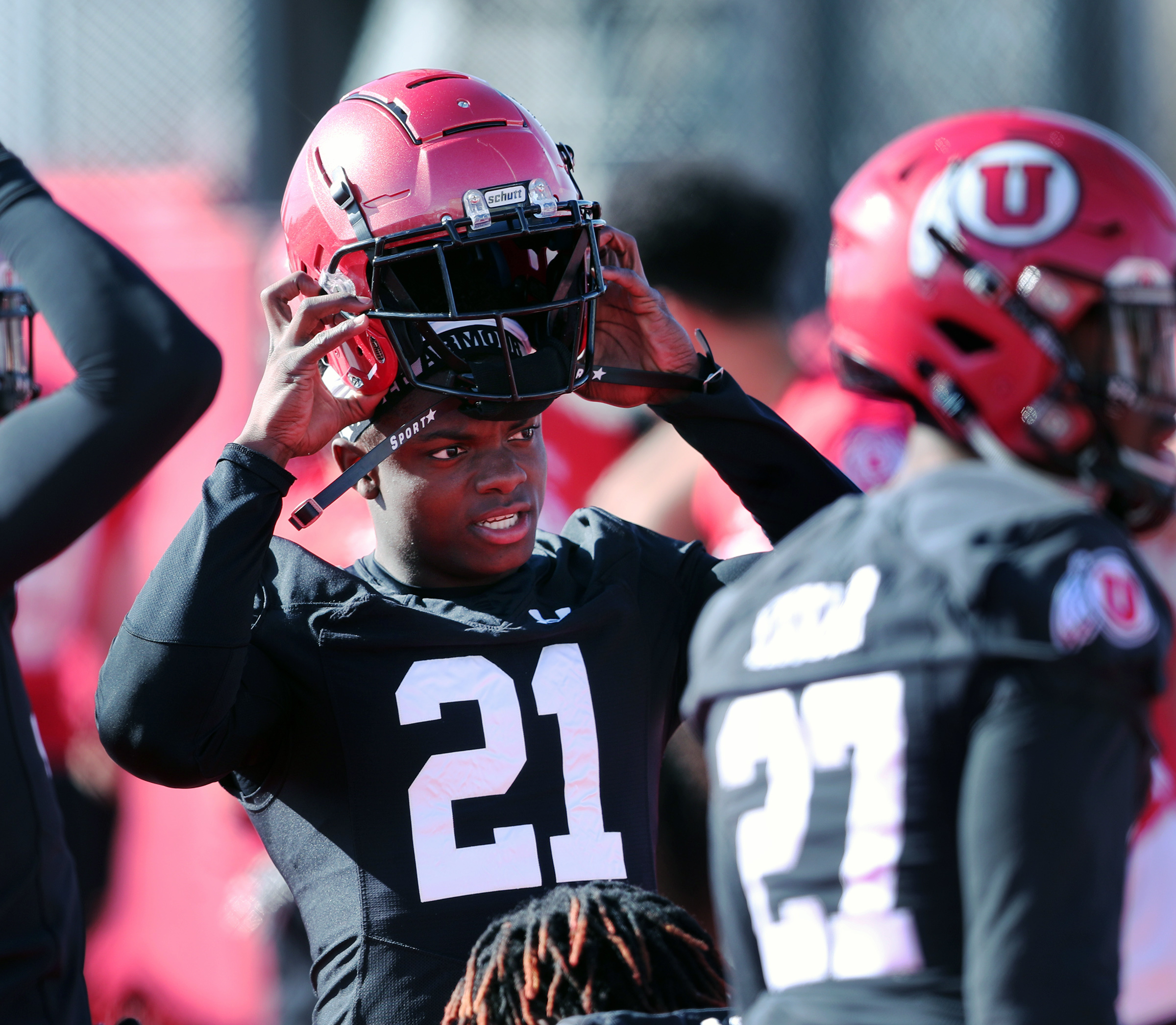 Cornerback Clark Phillips III puts on his helmet as he and the rest of the University of Utah football team open spring camp in Salt Lake City on Monday, March 2, 2020.