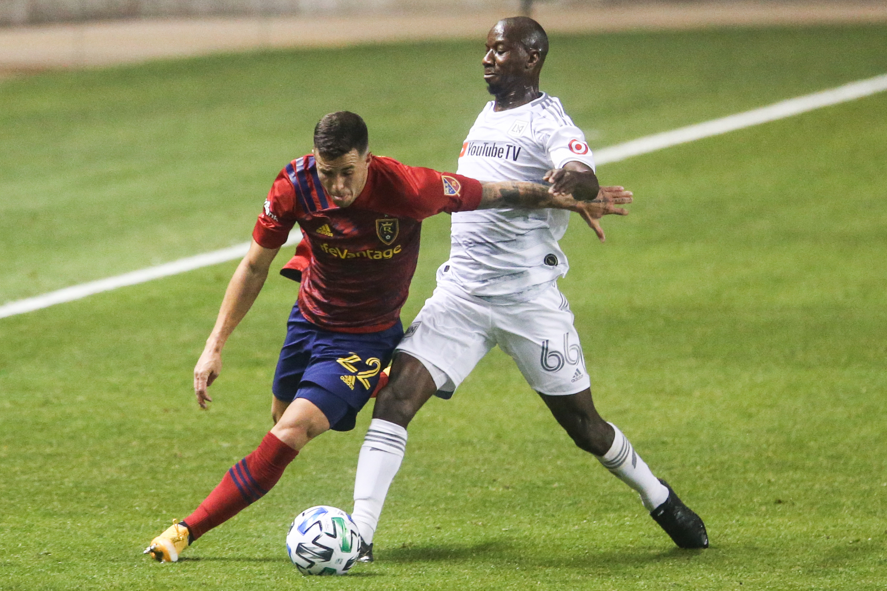 Real Salt Lake defender Aaron Herrera (22) dribbles against Los Angeles FC forward Bradley Wright-Phillips (66) during a MLS soccer game at Rio Tinto Stadium in Sandy on Sunday, Oct. 4, 2020.