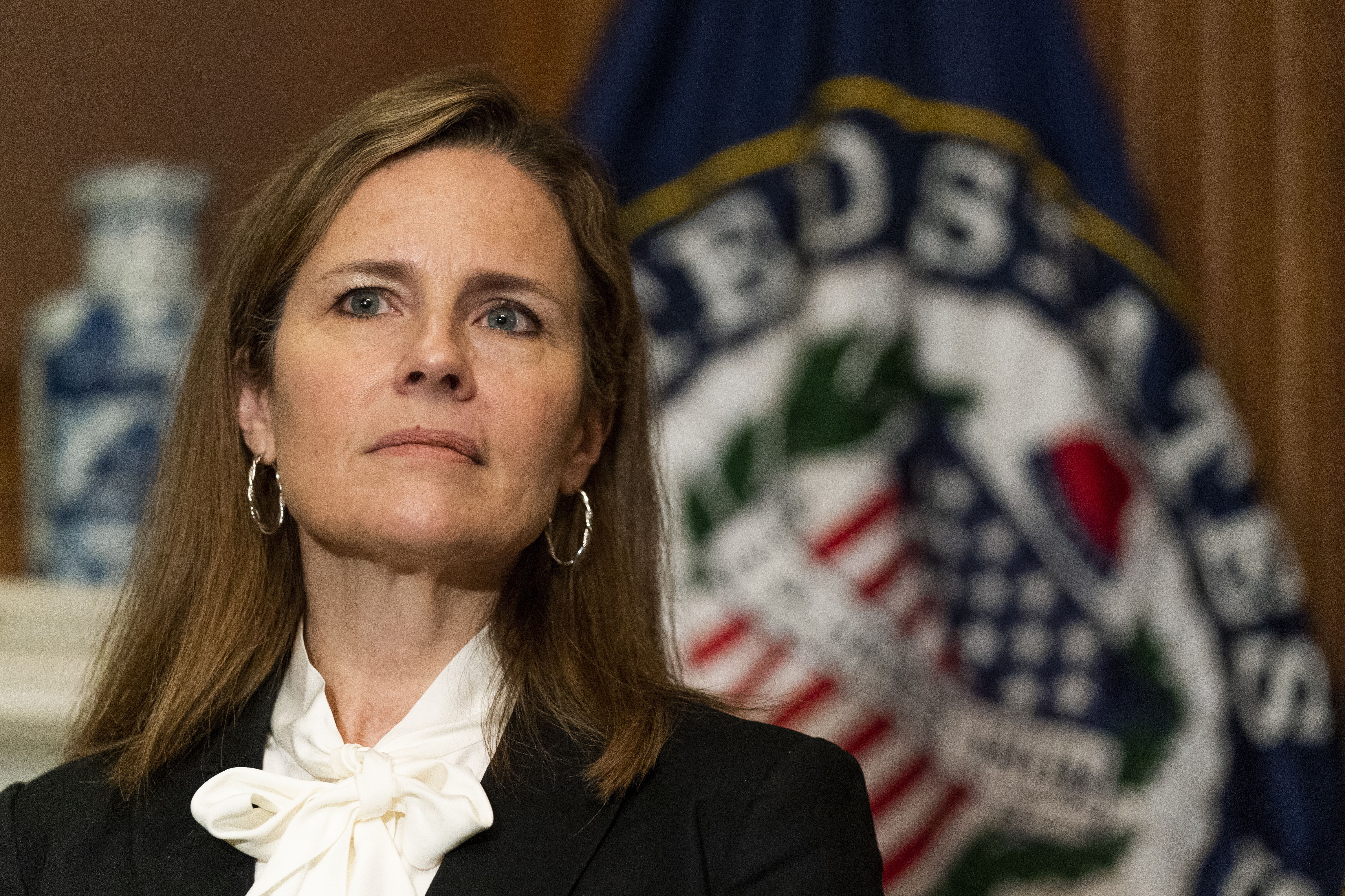 Supreme Court nominee Judge Amy Coney Barrett listens as Sen. Jerry Moran, R-Kan., not shown, speaks during their meeting on Capitol Hill, Thursday, Oct. 1, 2020, in Washington.