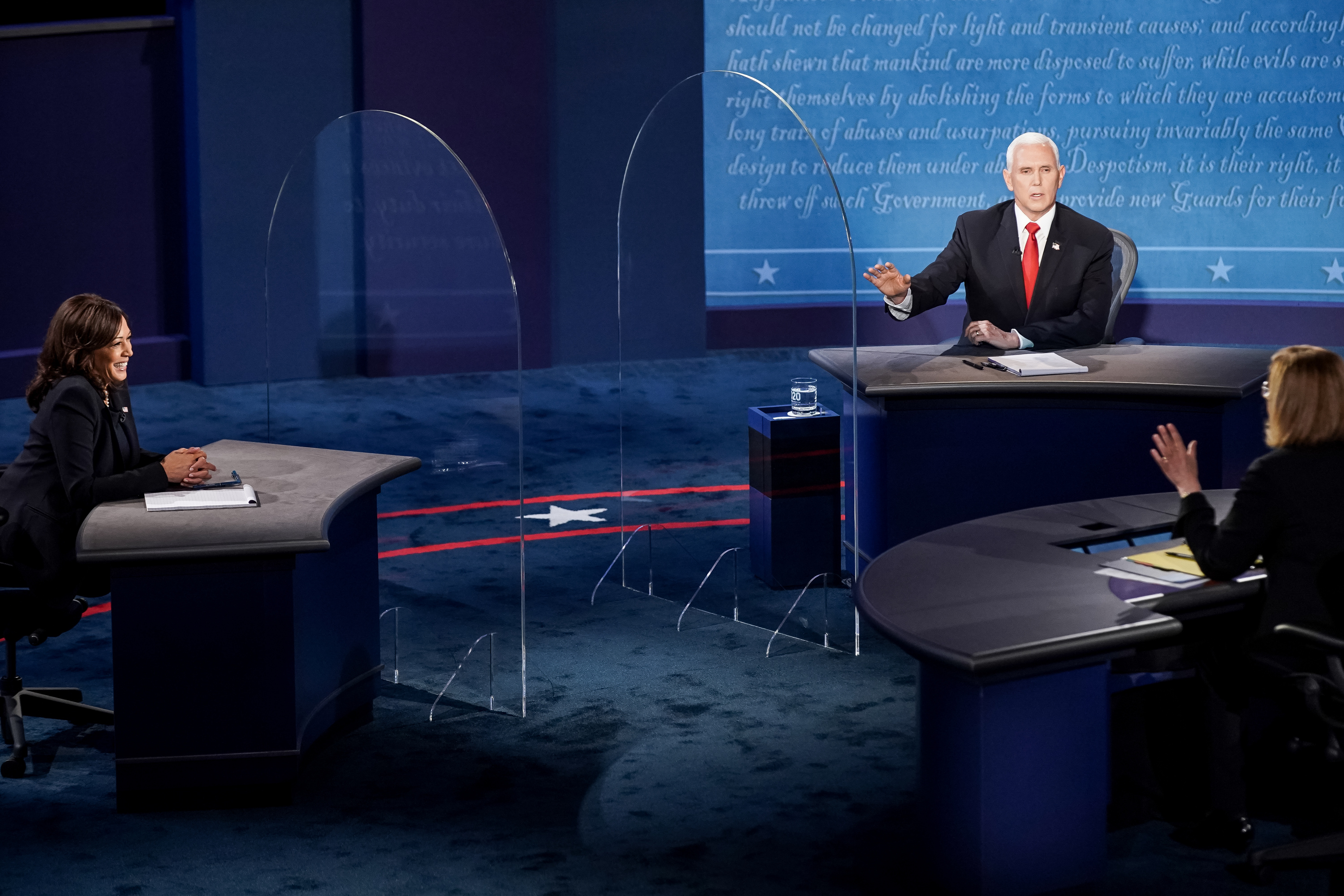 Moderator Susan Page tries to reign in Vice President Mike Pence as he talks past his allotted time during his debate against Democratic challenger Sen. Kamala Harris, D-Calif., in the vice presidential debate at Kingsbury Hall at the University of Utah in Salt Lake City on Wednesday, Oct. 7, 2020.
