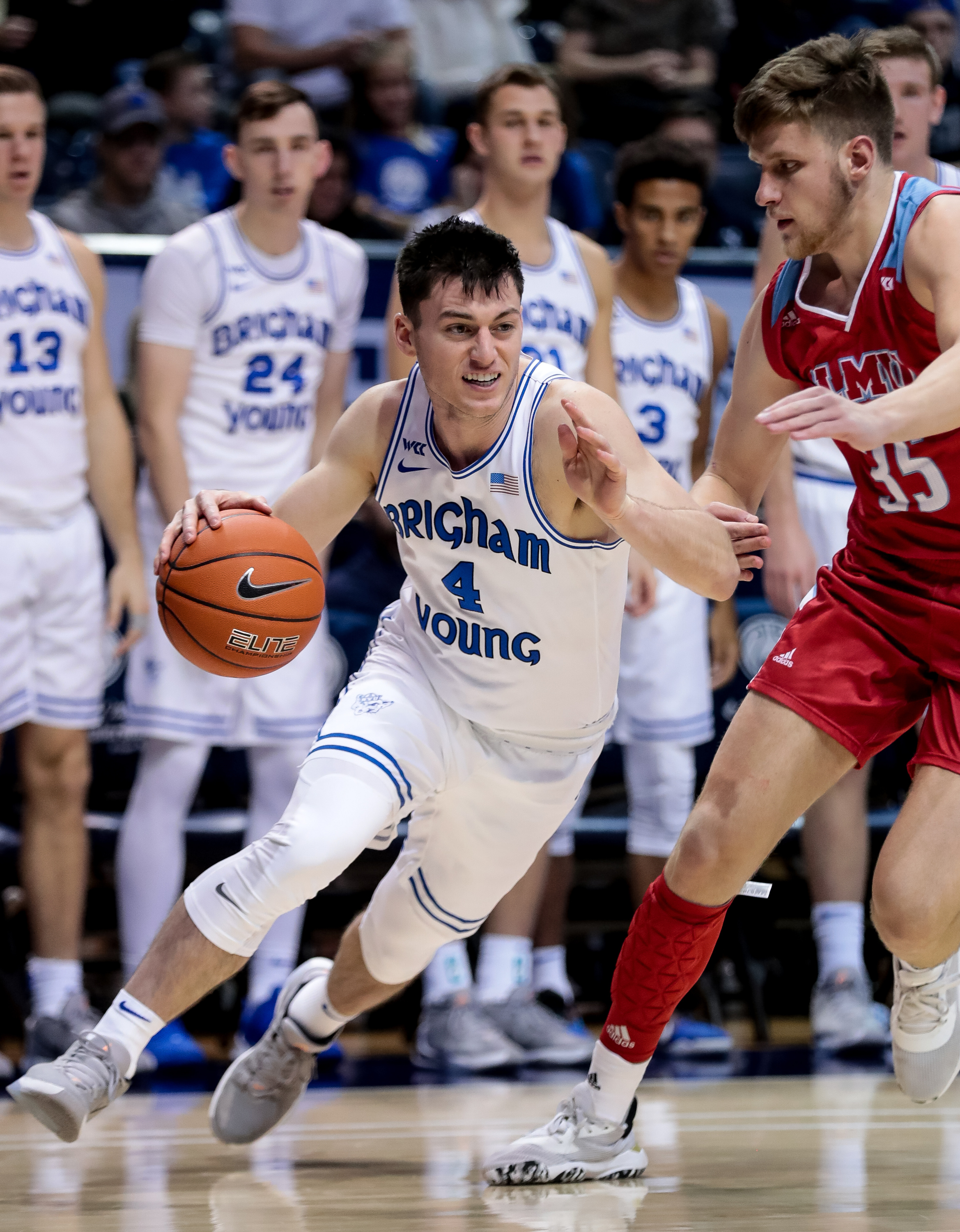 Brigham Young Cougars guard Alex Barcello (4) drives around Loyola Marymount Lions forward Ivan Alipiev (35) during the game at the Marriott Center in Provo on Saturday, Jan. 4, 2020.