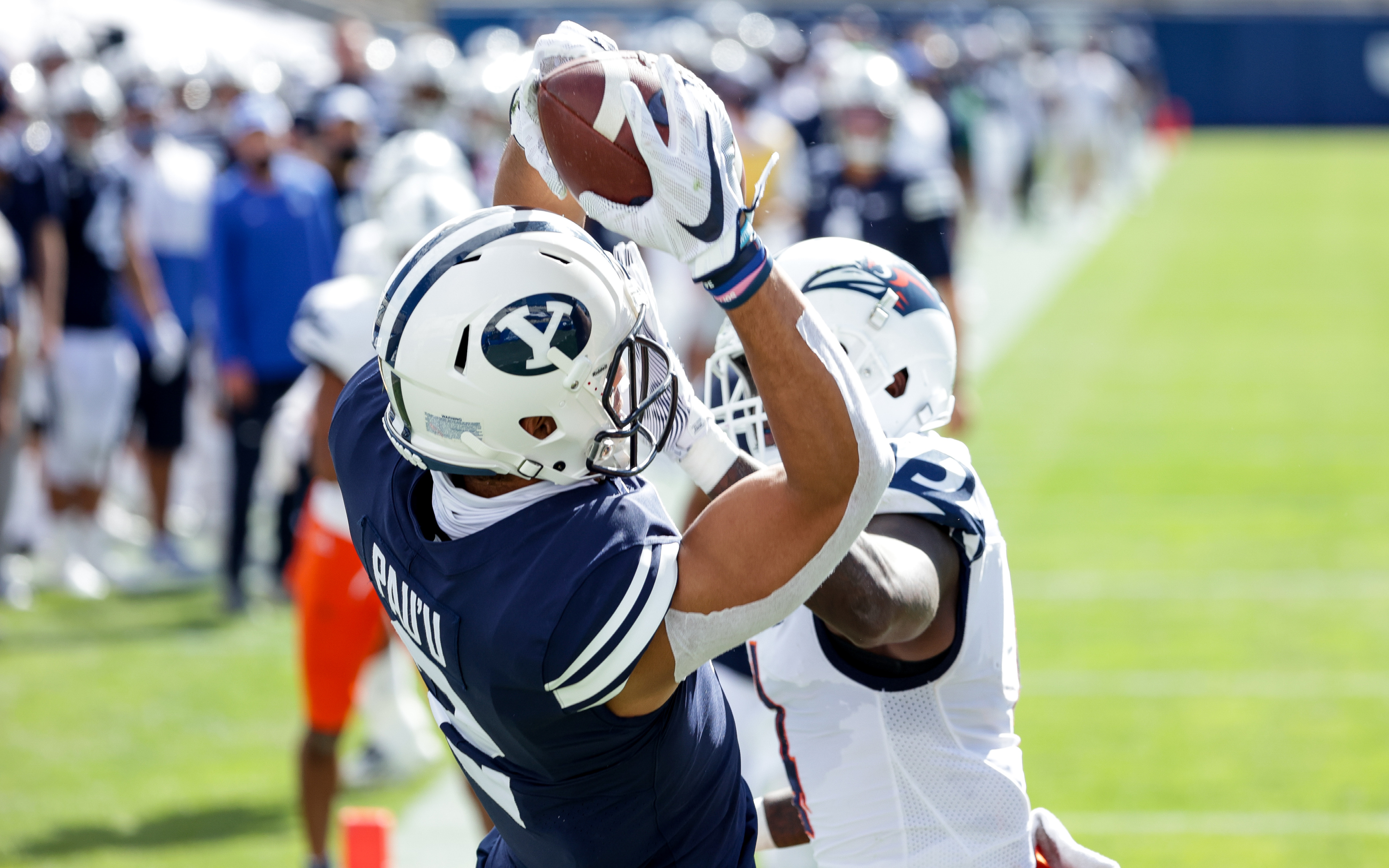 Brigham Young Cougars wide receiver Neil Pau'u (2) pulls in an end zone pass ahead of UTSA Roadrunners safety Antonio Parks (4), putting the Cougars up 7-3 after the PAT during the game at LaVell Edwards Stadium in Provo on Saturday, Oct. 10, 2020.