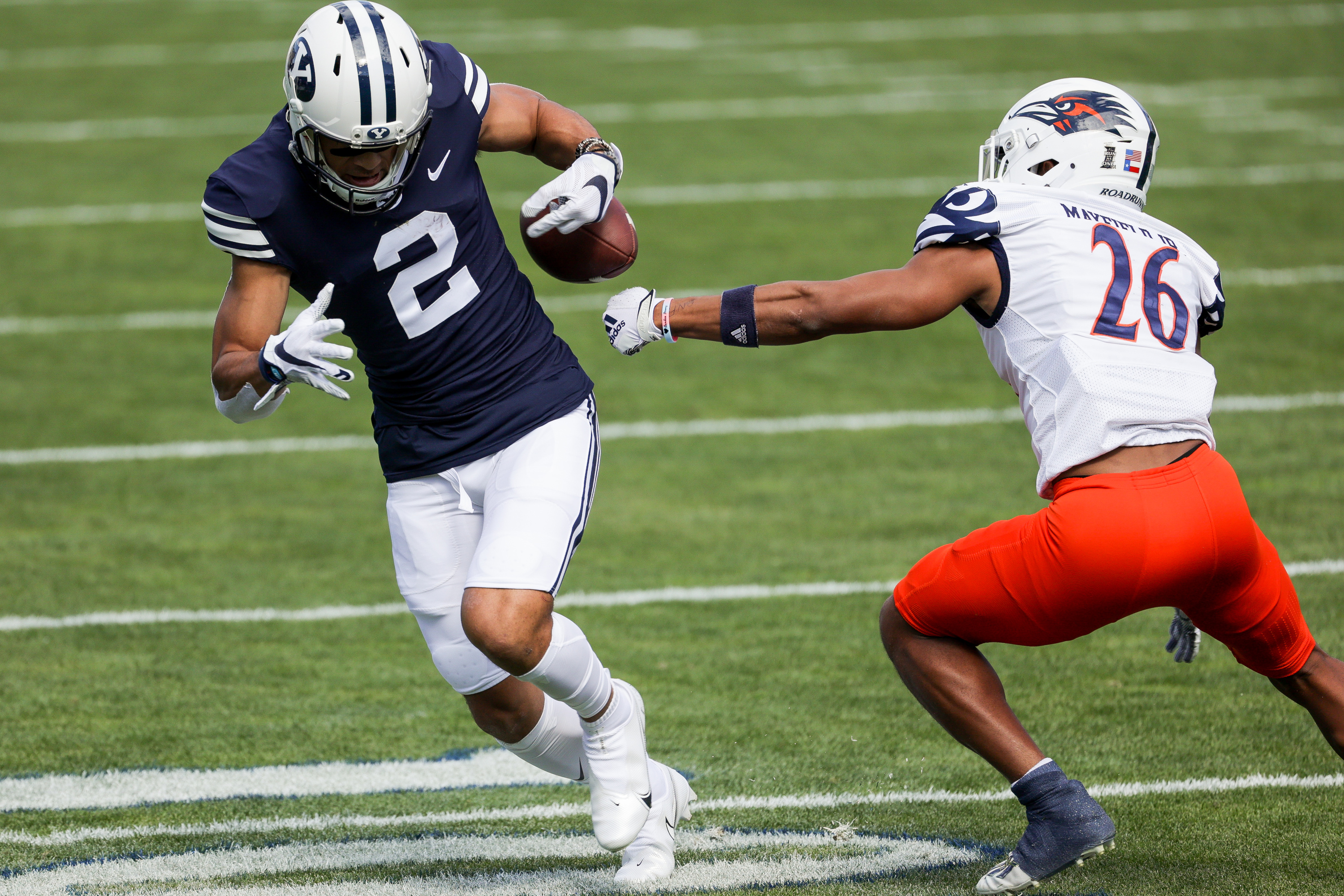 UTSA Roadrunners cornerback Corey Mayfield Jr. (26) forces a fumble from Brigham Young Cougars wide receiver Neil Pau'u (2) during the game at LaVell Edwards Stadium in Provo on Saturday, Oct. 10, 2020.
