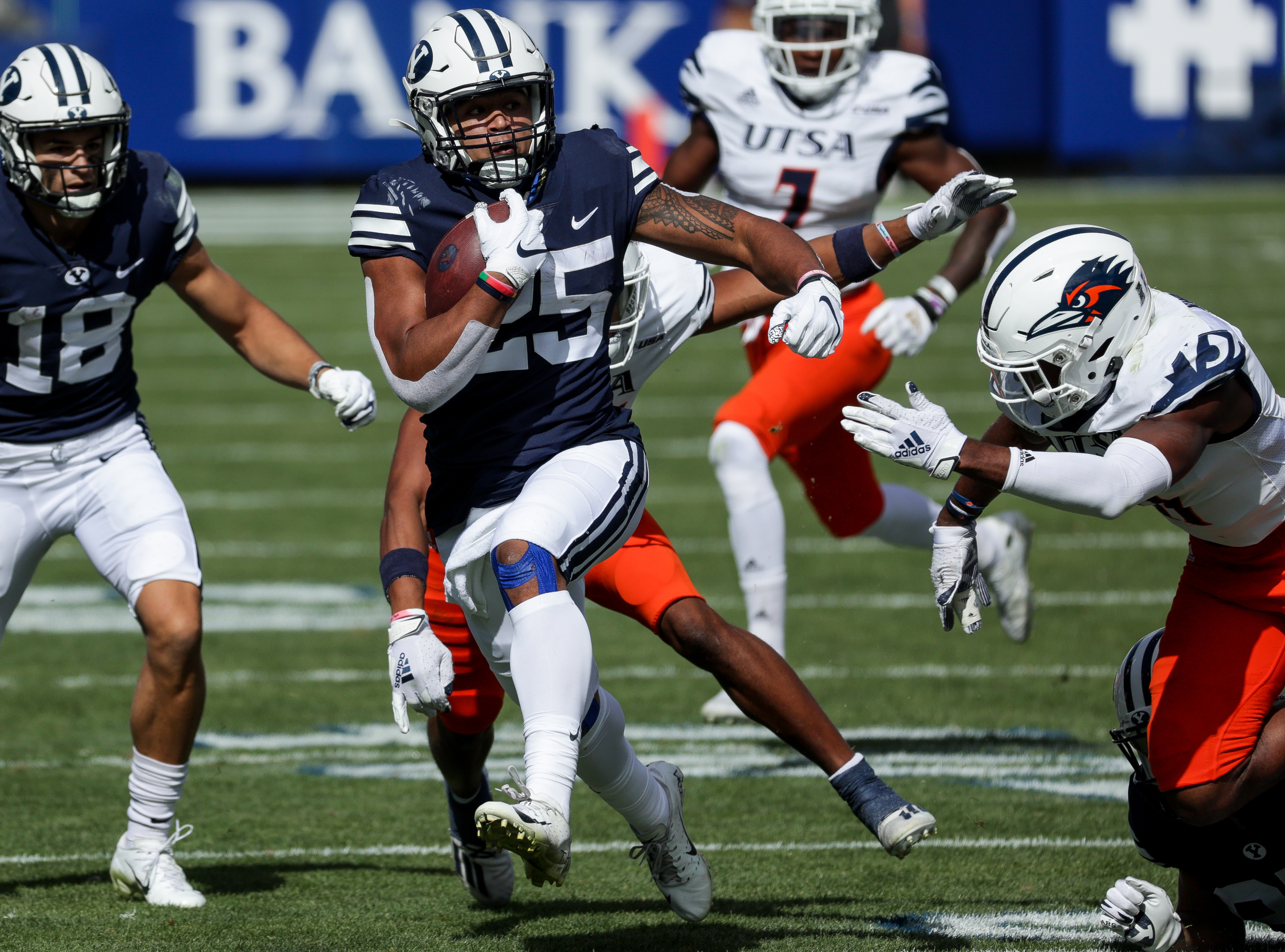 Brigham Young Cougars running back Tyler Allgeier (25) runs the ball during the game against the UTSA Roadrunners at LaVell Edwards Stadium in Provo on Saturday, Oct. 10, 2020.