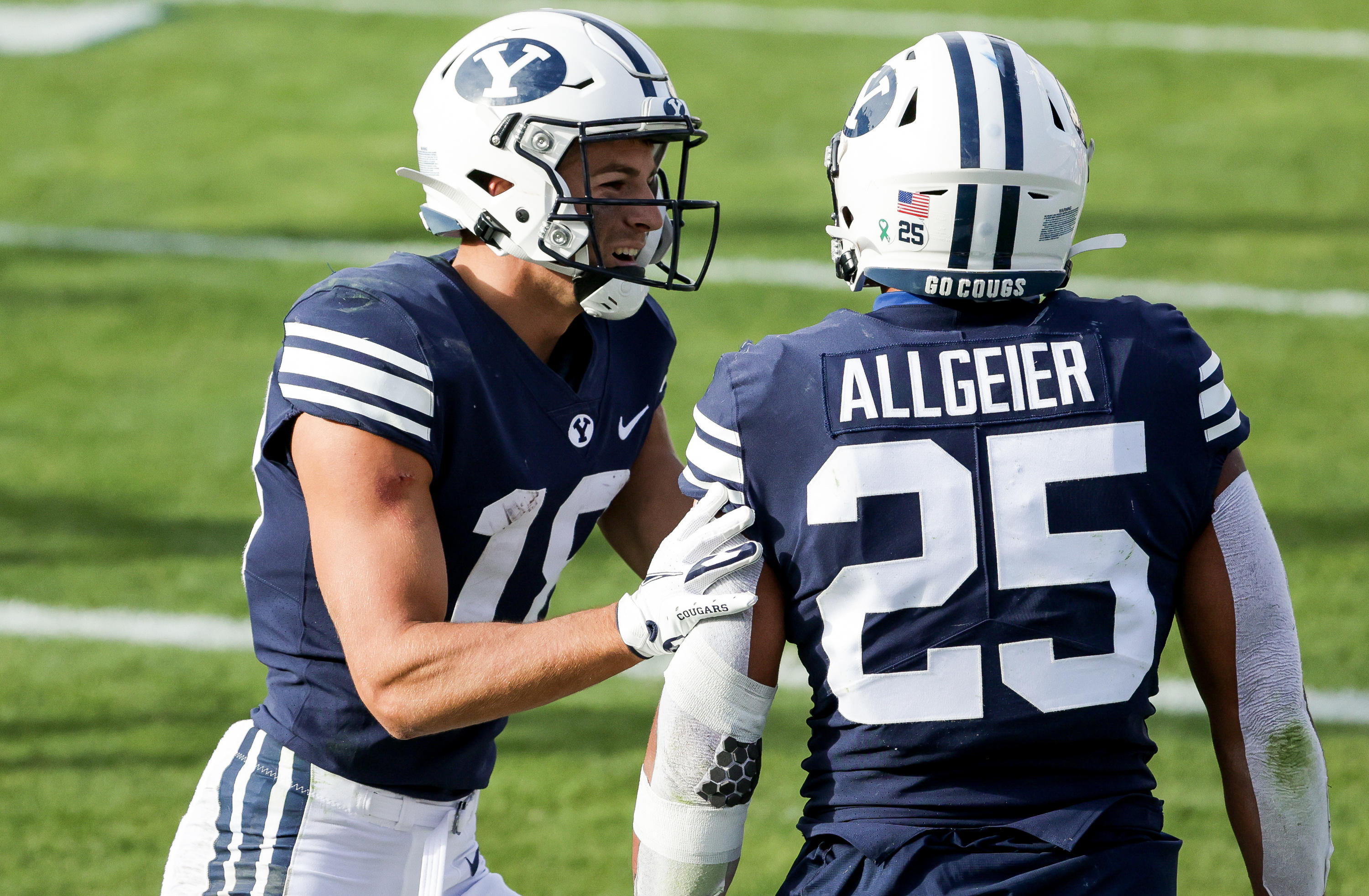 Brigham Young Cougars wide receiver Gunner Romney (18) and running back Tyler Allgeier (25) celebrate after Allgeier ran for a touchdown during the game against the UTSA Roadrunners at LaVell Edwards Stadium in Provo on Saturday, Oct. 10, 2020.