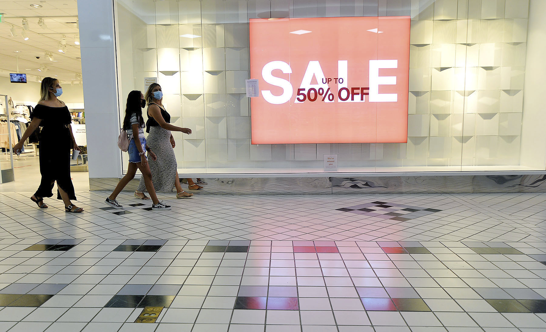 In this Aug. 11, 2020 file photo, shoppers walk through the Valley Mall in Halfway, Md. U.S. consumer confidence rebounded more quickly in September than most economists had expected, but it remains well below levels that preceded the pandemic.