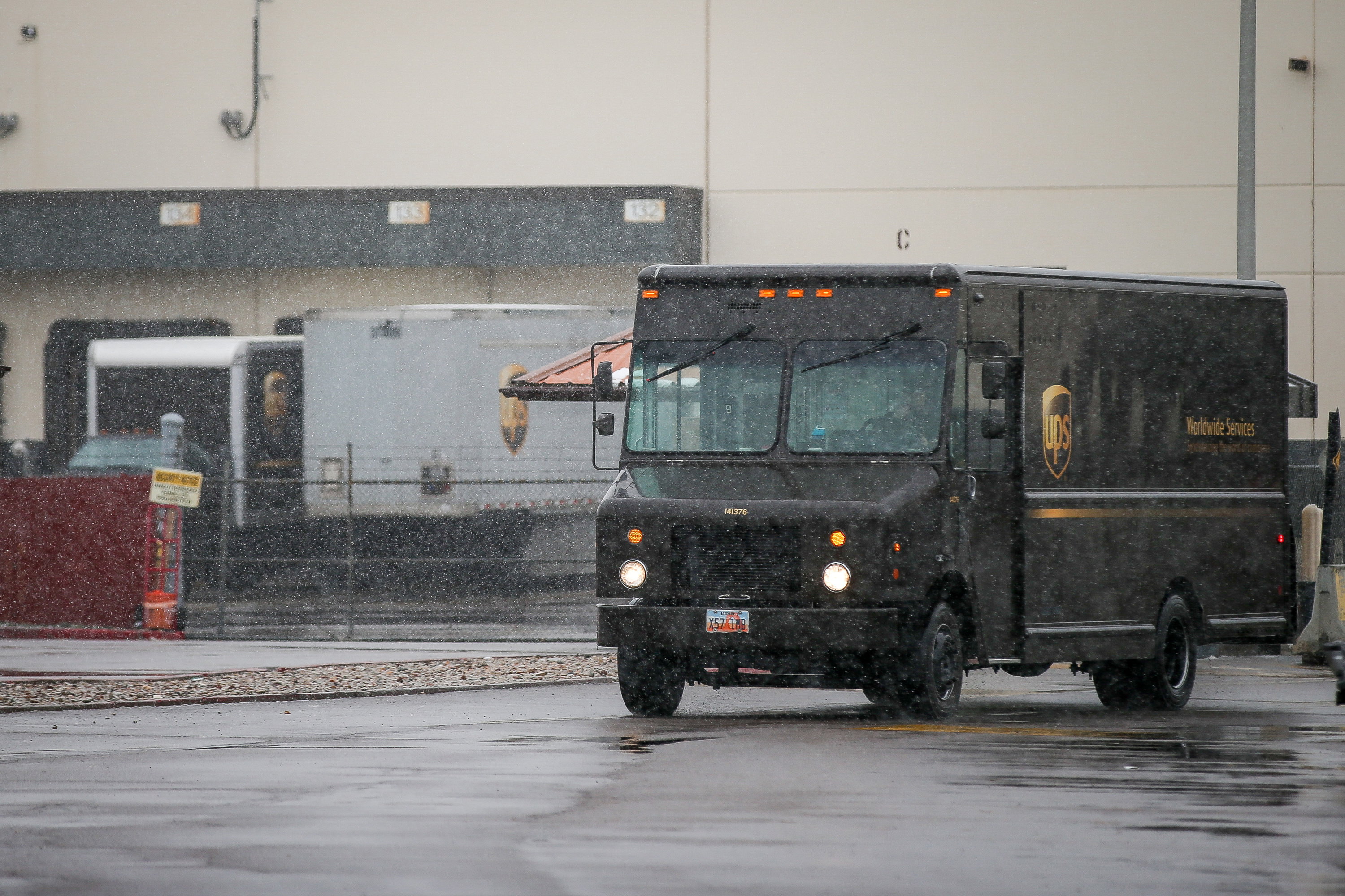 A truck leaves a UPS facility in West Valley City, Utah, on Wednesday, Nov. 27, 2019.