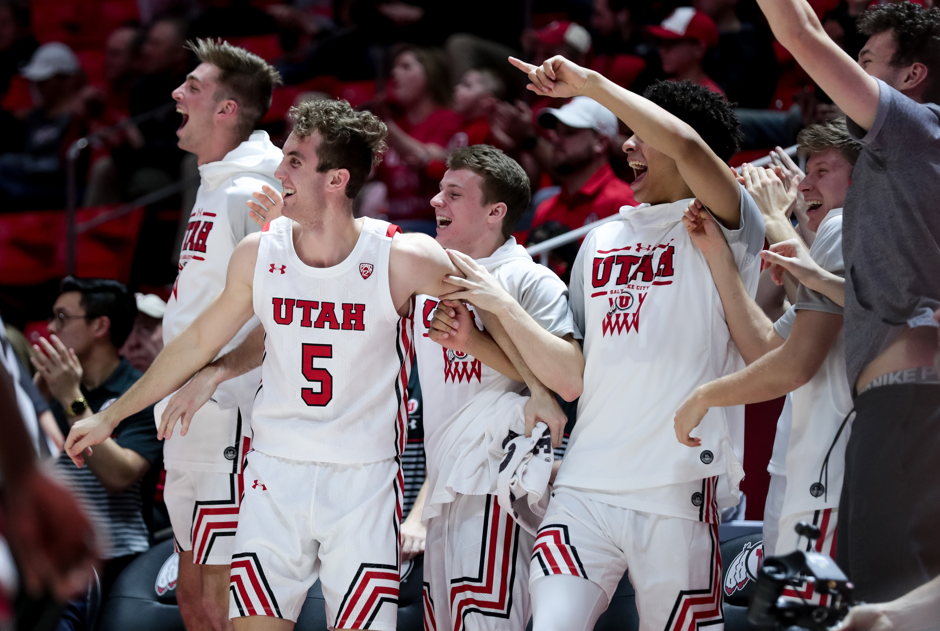 Utah Utes players cheer as they lead the Washington State Cougars in the final moments of the game at the Huntsman Center in Salt Lake City on Saturday, Jan. 25, 2020.
