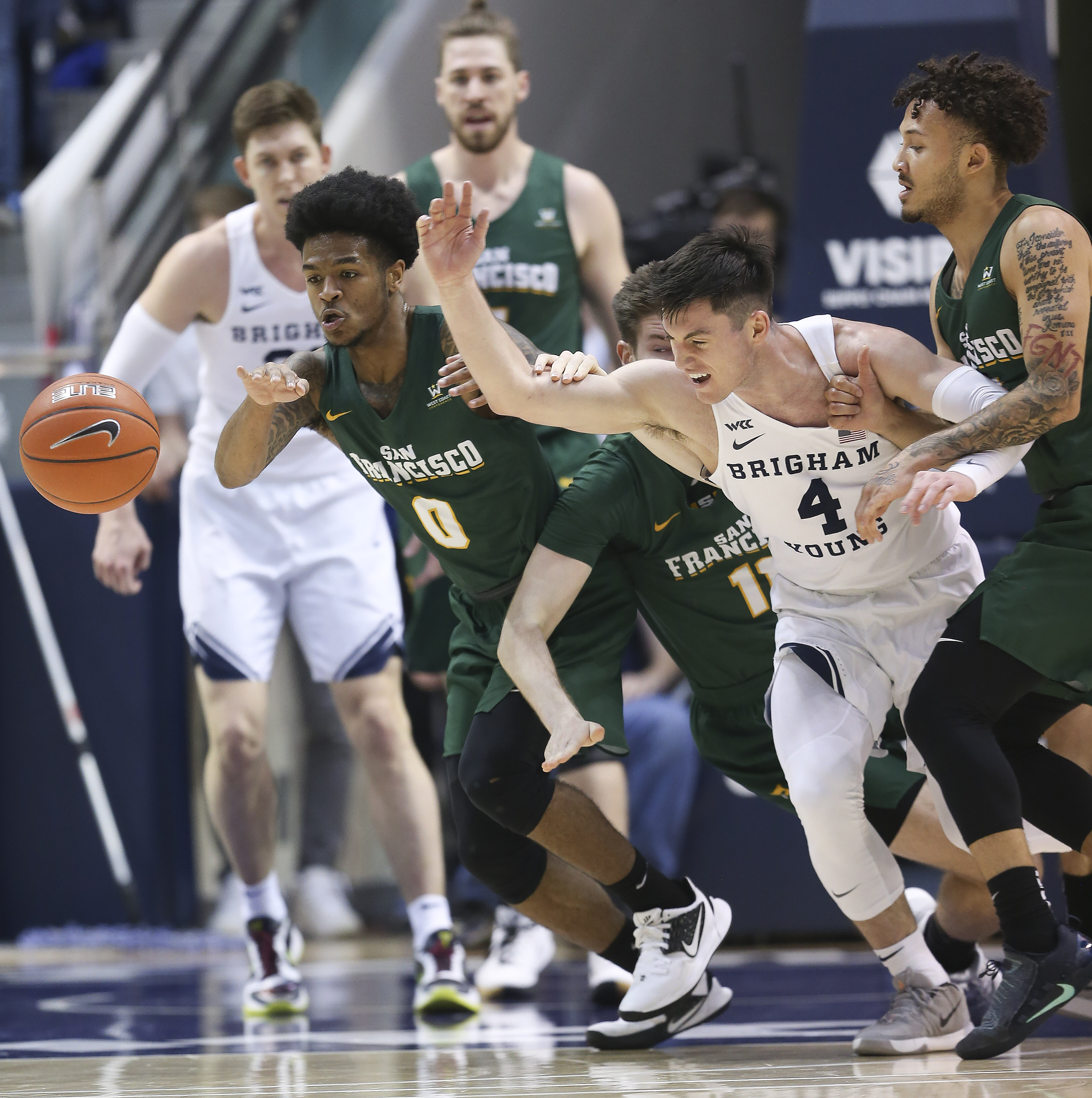Brigham Young Cougars guard Alex Barcello (4) and San Francisco Dons guard Khalil Shabazz (0) fight for the ball in Provo on Saturday, Feb. 8, 2020. BYU won 90-76.