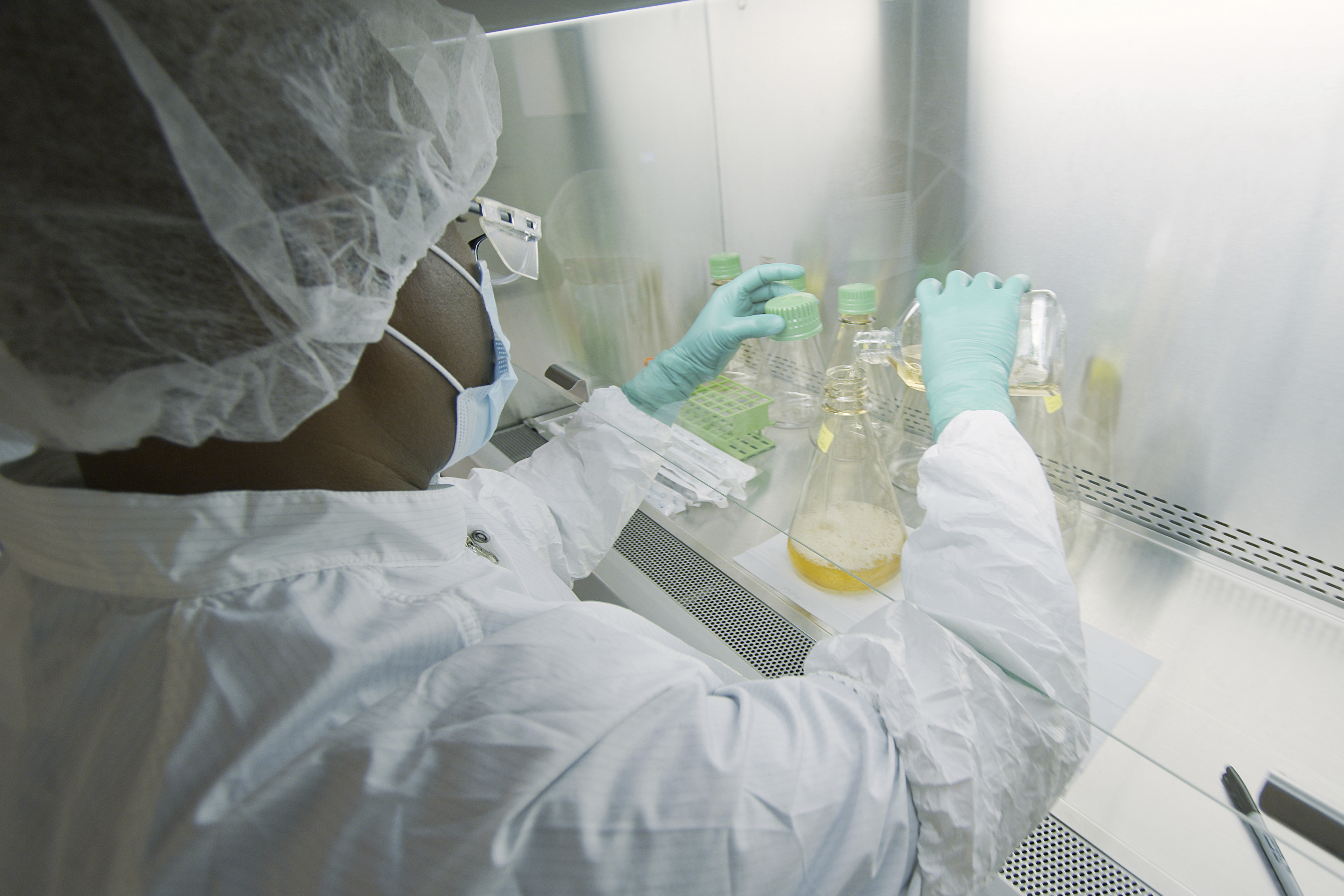 In this May 2020 photo provided by Eli Lilly, a researcher tests possible COVID-19 antibodies in a laboratory in Indianapolis. Antibodies are proteins the body makes when an infection occurs; they attach to a virus and help it be eliminated.