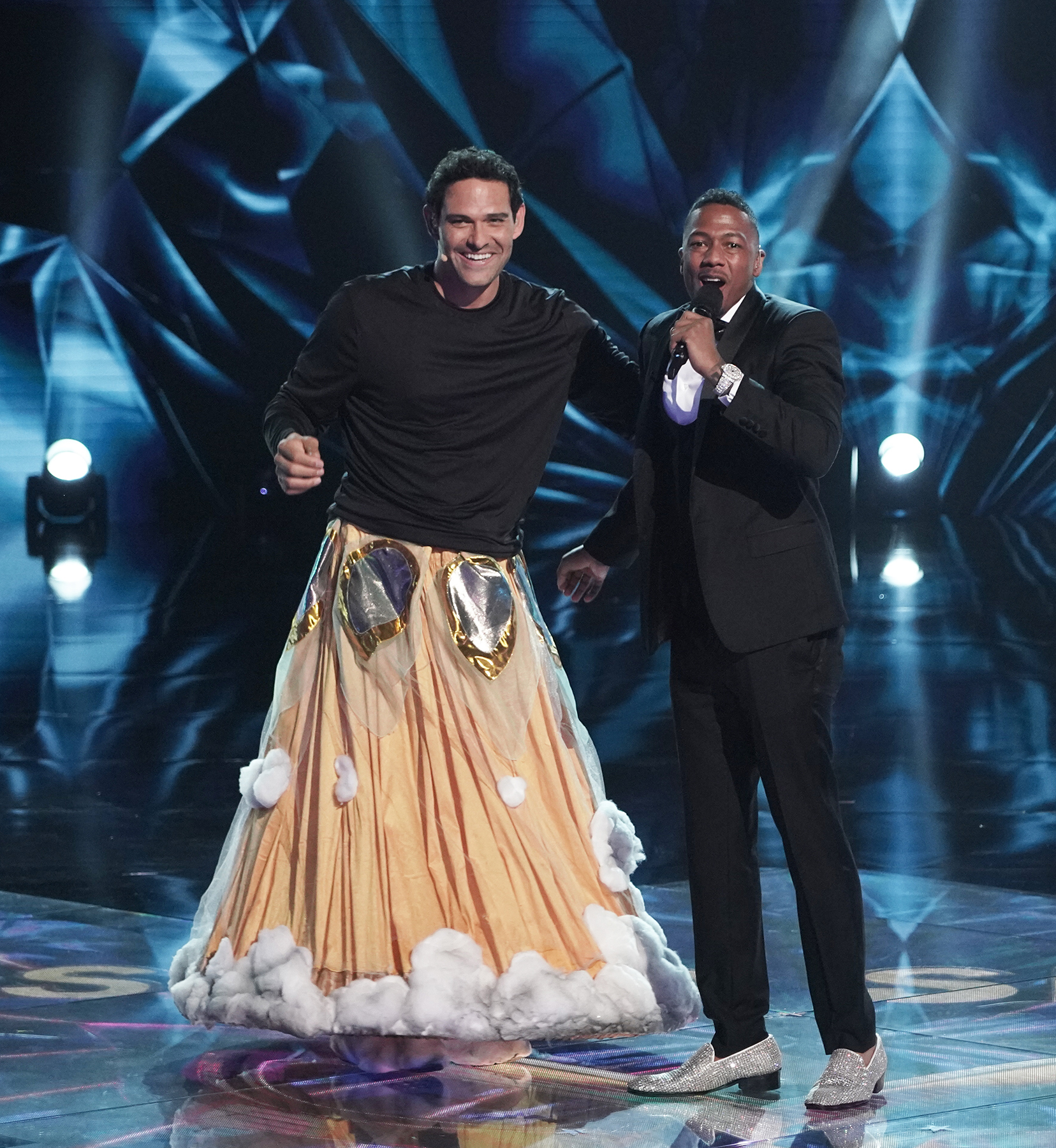 """THE MASKED SINGER: L-R: Mark Sanchez and host Nick Cannon in the """"The Group B Play Offs - Cloudy with a Chance of Clues"""" episode of THE MASKED SINGER airing Wednesday, Oct. 14 (8:00-9:00 PM ET/PT) on FOX."""